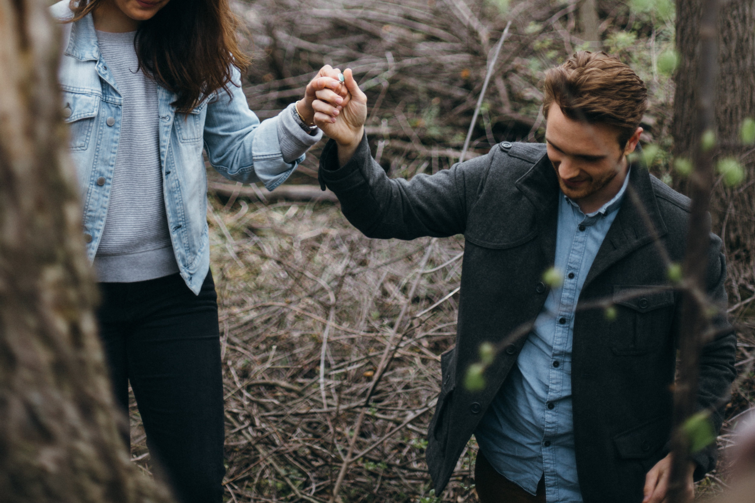 Engagement session in the woods photographed by Minneapolis wedding photographer Britt DeZeeuw