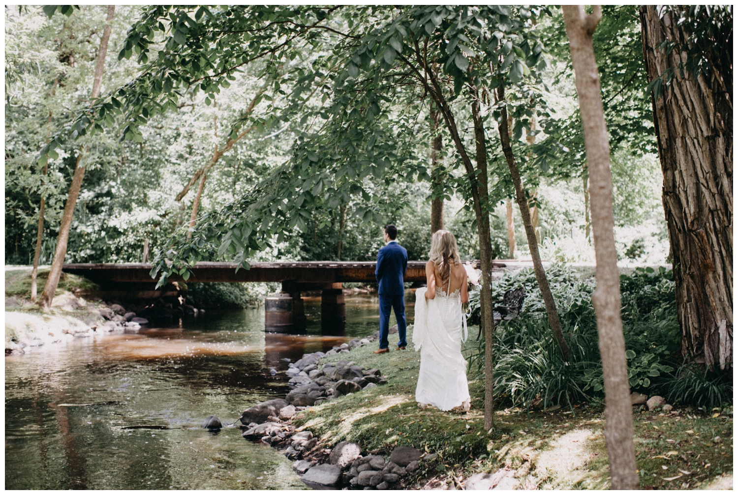 Bride and groom first look at Creekside Farm wedding photographed by Britt DeZeeuw