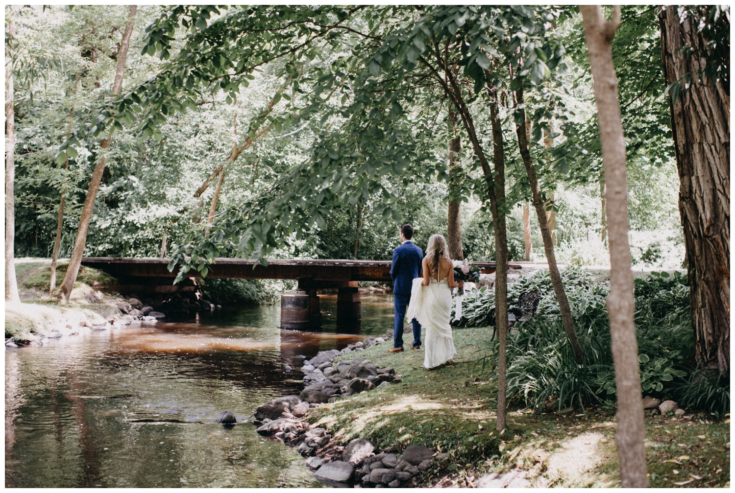 First look by the creek at barn wedding in Rush City, MN
