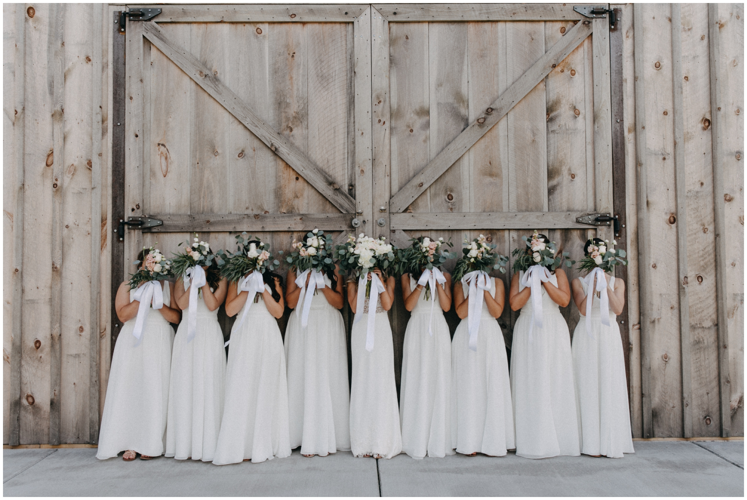 Bridesmaids wearing all white dresses at Creekside Farm wedding