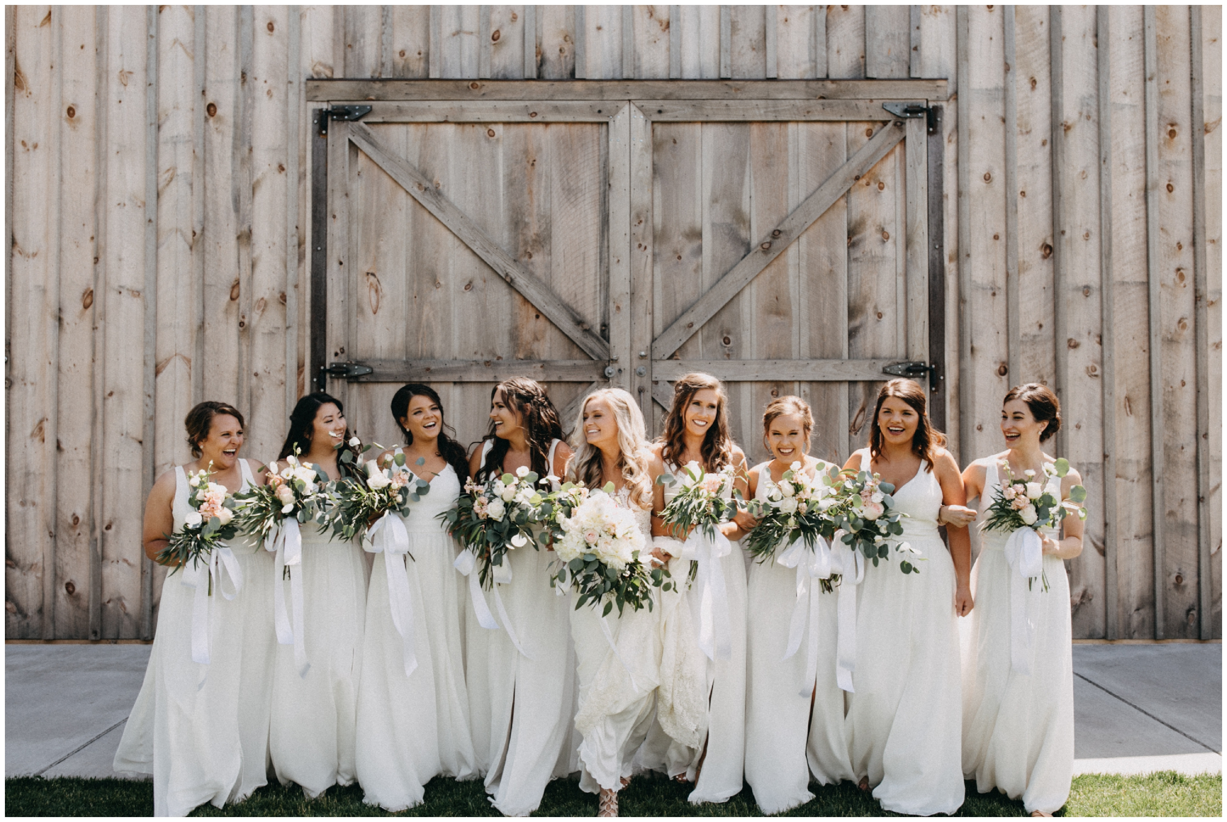 Bridesmaids in white dresses at Creekside Farm wedding