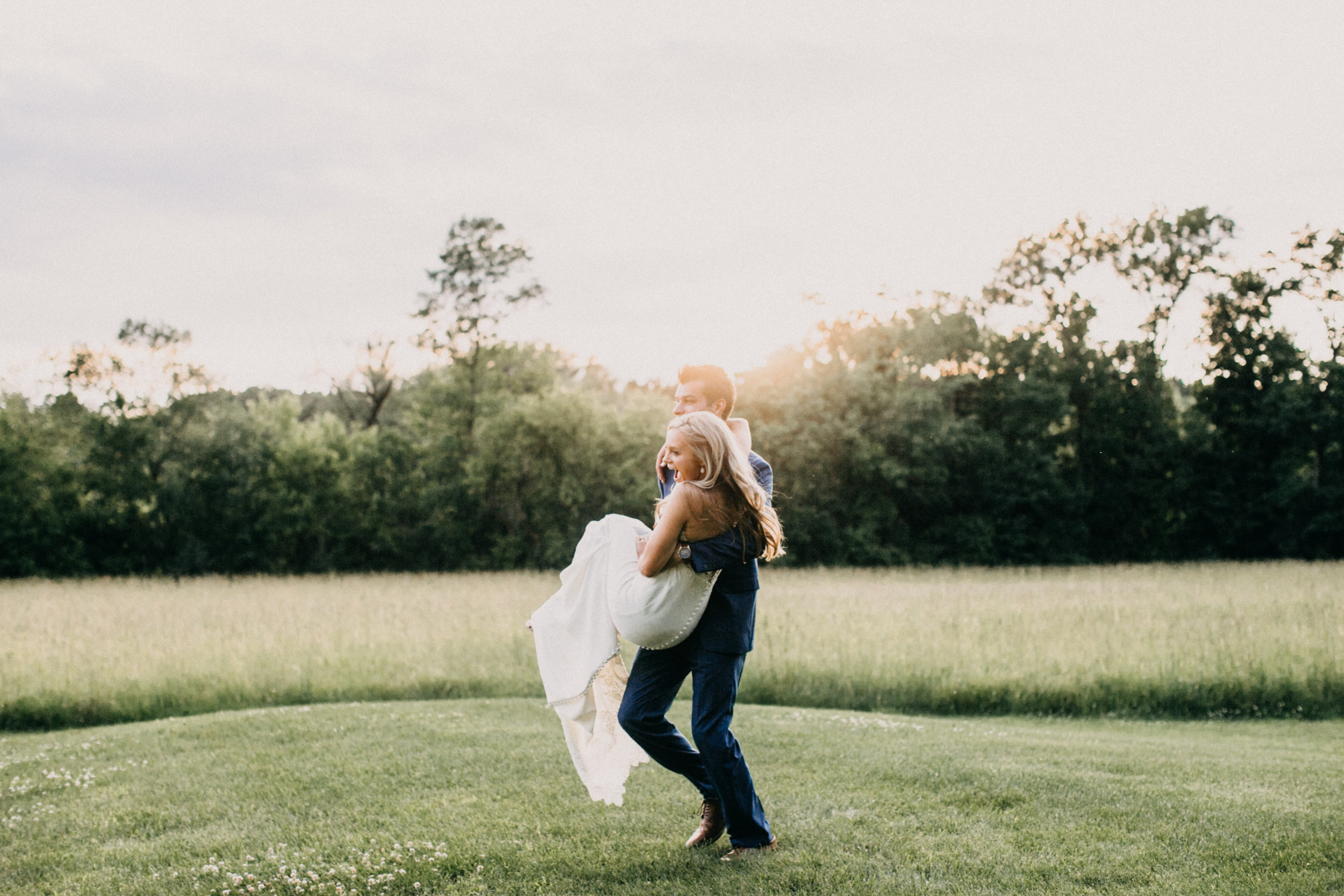 Candid portraits with bride and groom during sunset at Creekside Farm