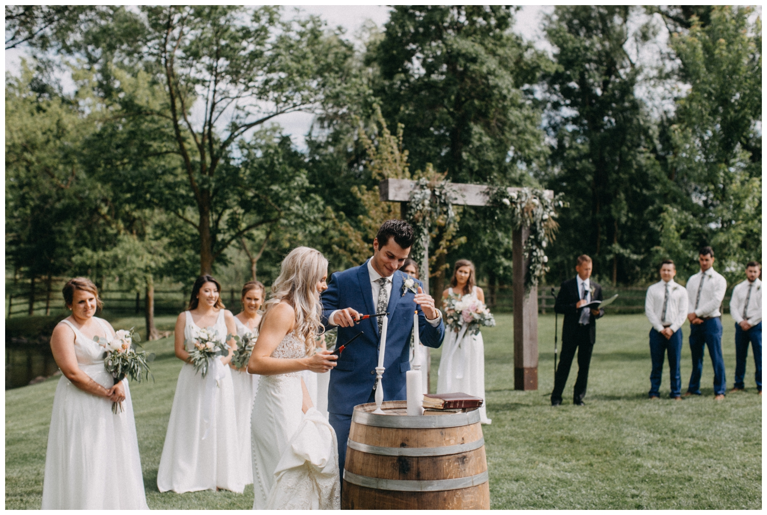 Outdoor summer wedding ceremony at Creekside Farm in Rush City, Minnesota