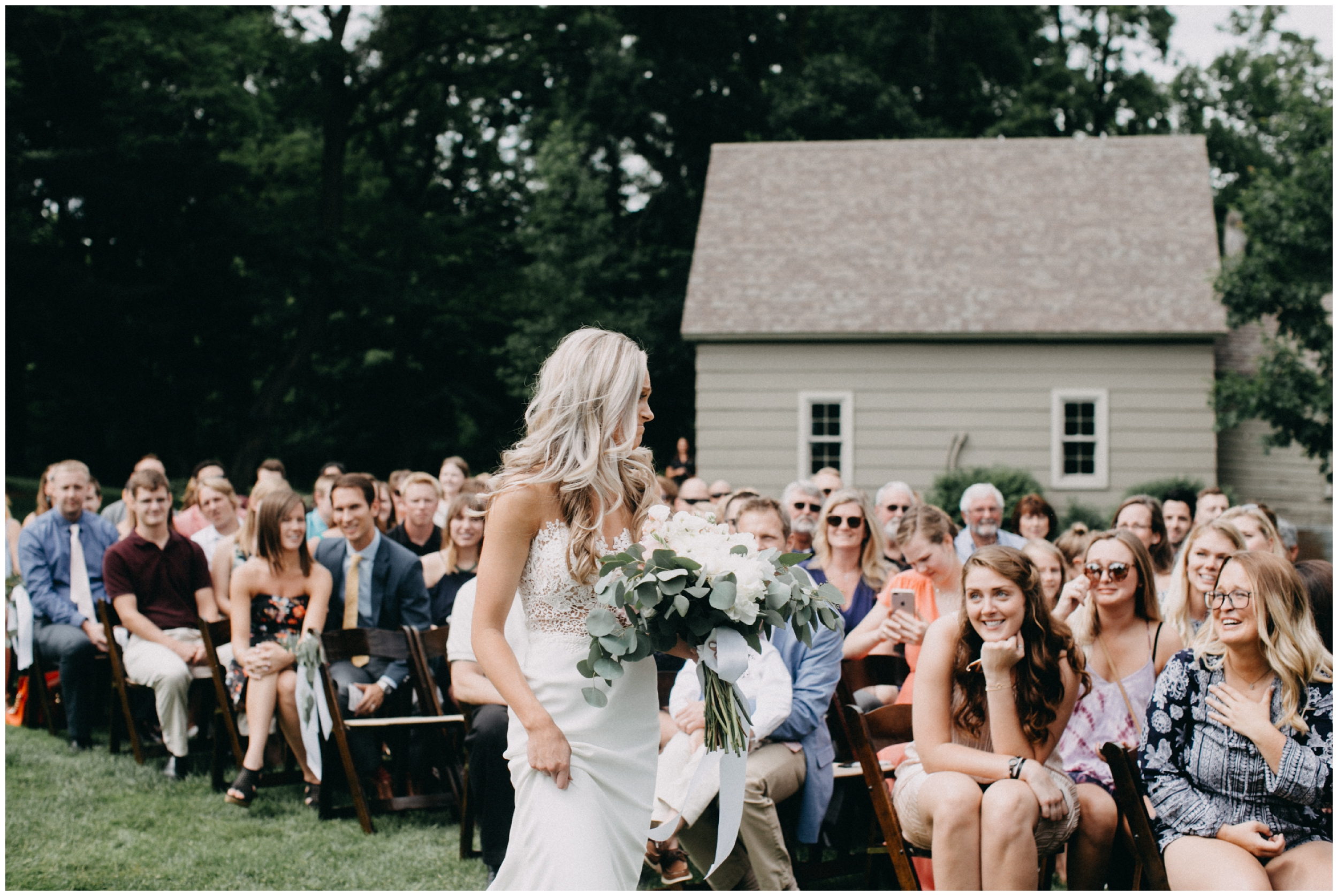 Emotional bride walking down aisle at Creekside Farm wedding ceremony