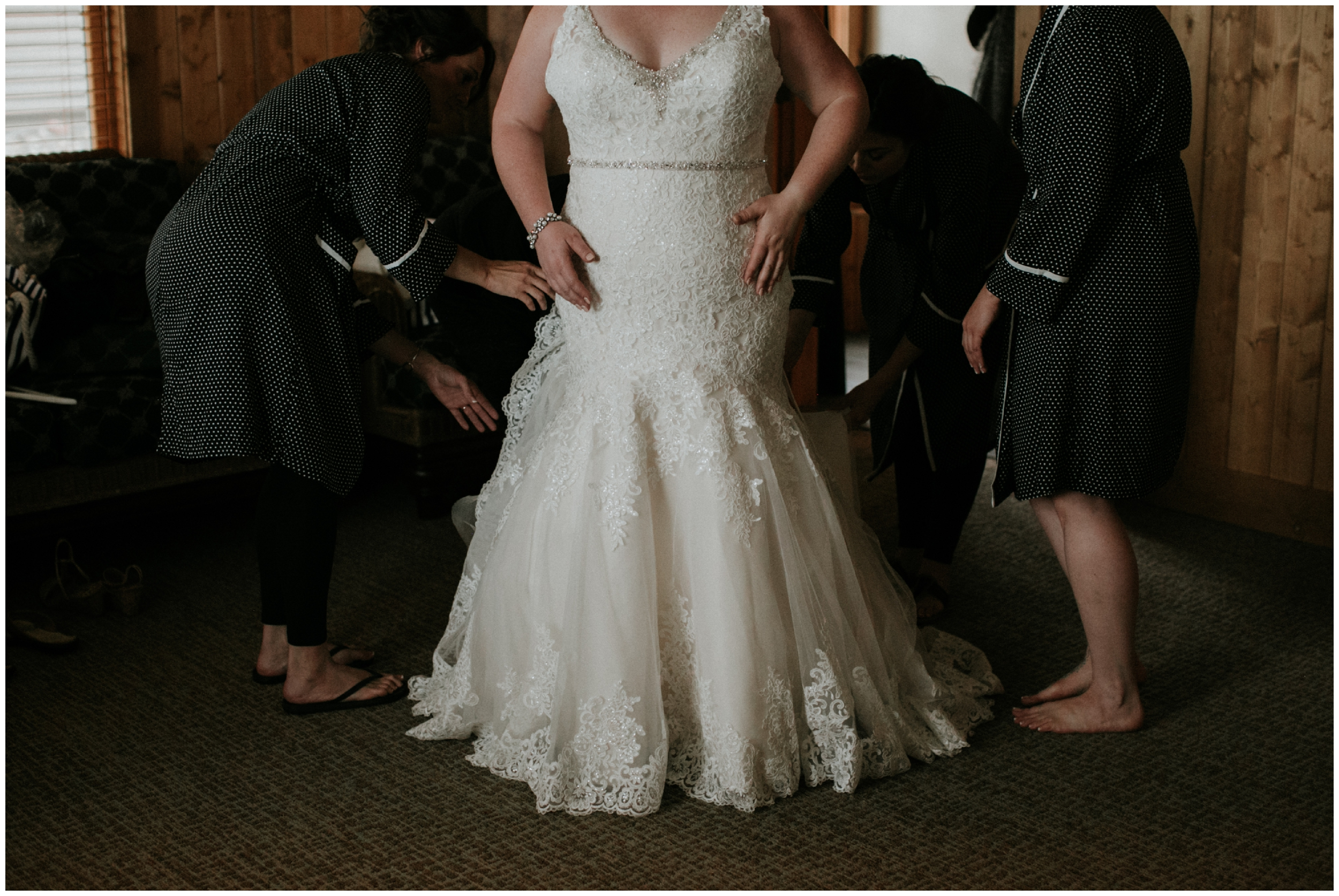 Bride getting into wedding dress at Madden's resort