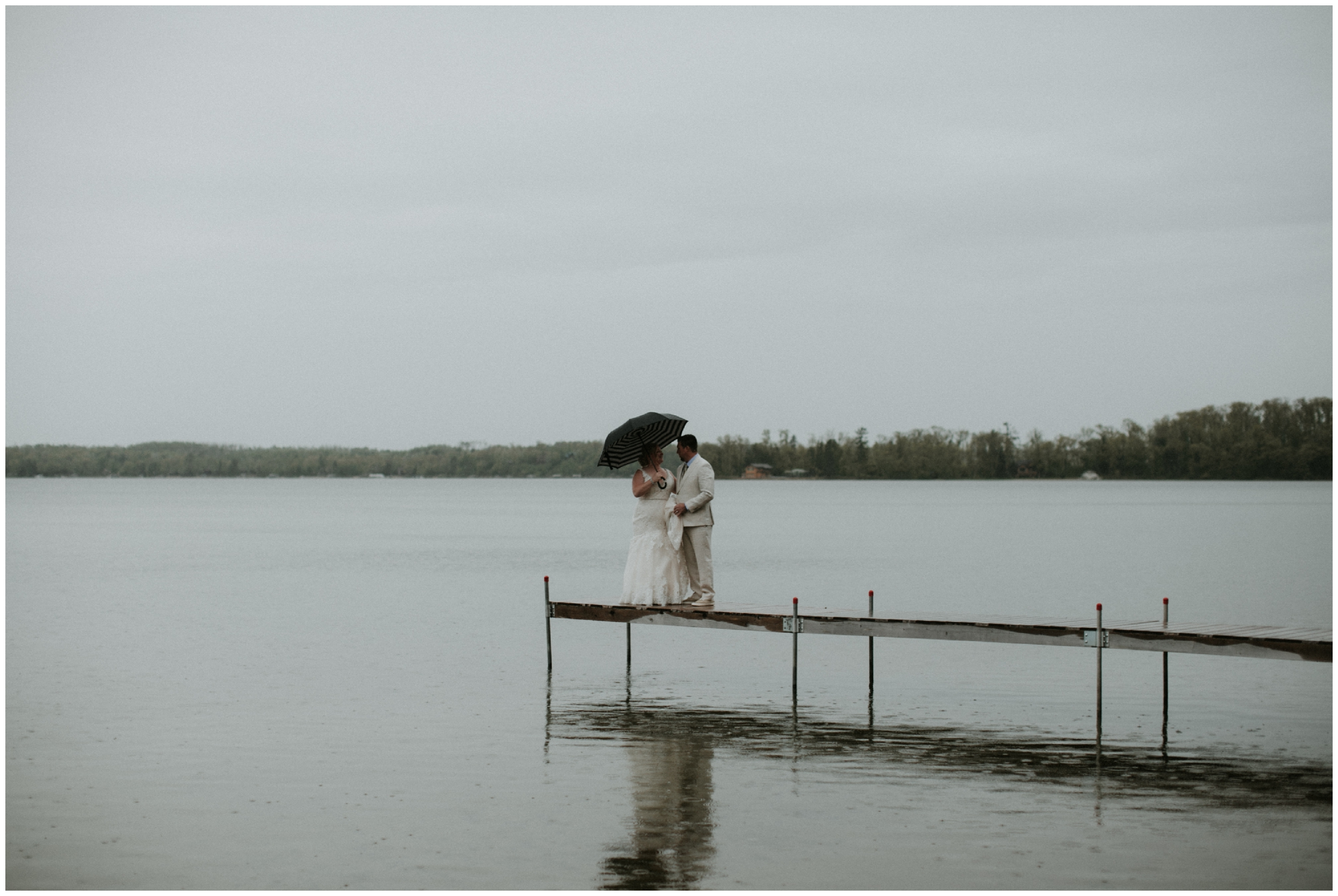 Rainy outdoor spring wedding at Madden's Resort on Gull Lake