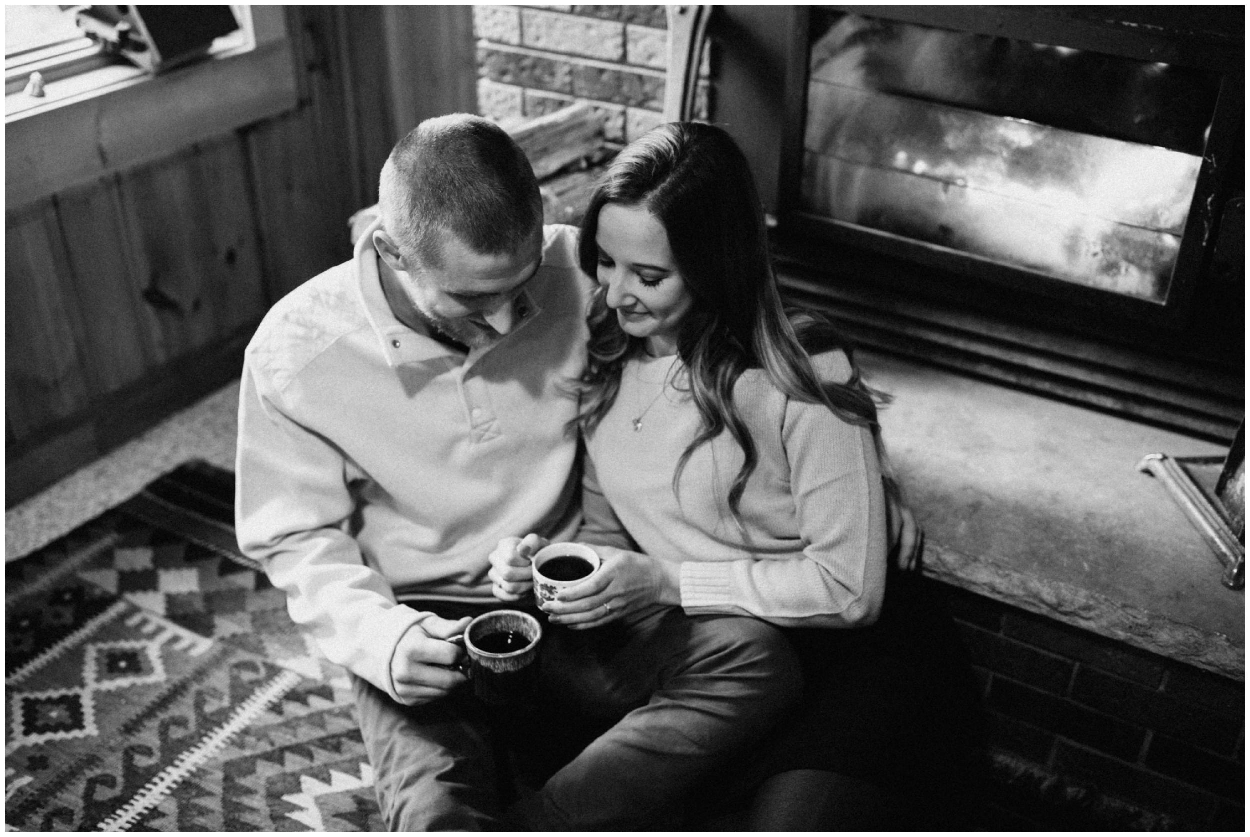 Cozy cabin engagement session by the fire in Hackensack, MN