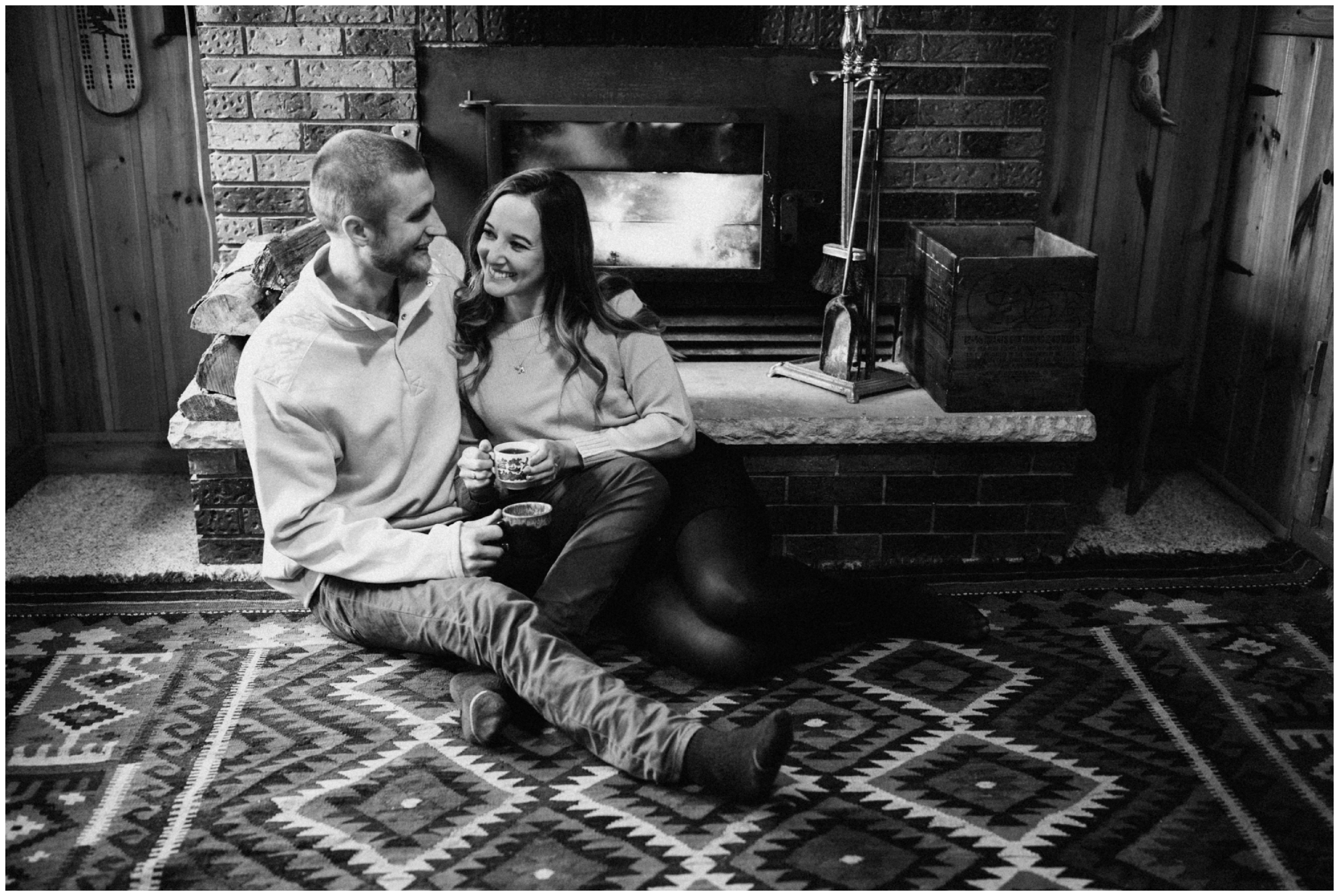 Casual in home engagement session at lakeside cabin in the woods in northern MN