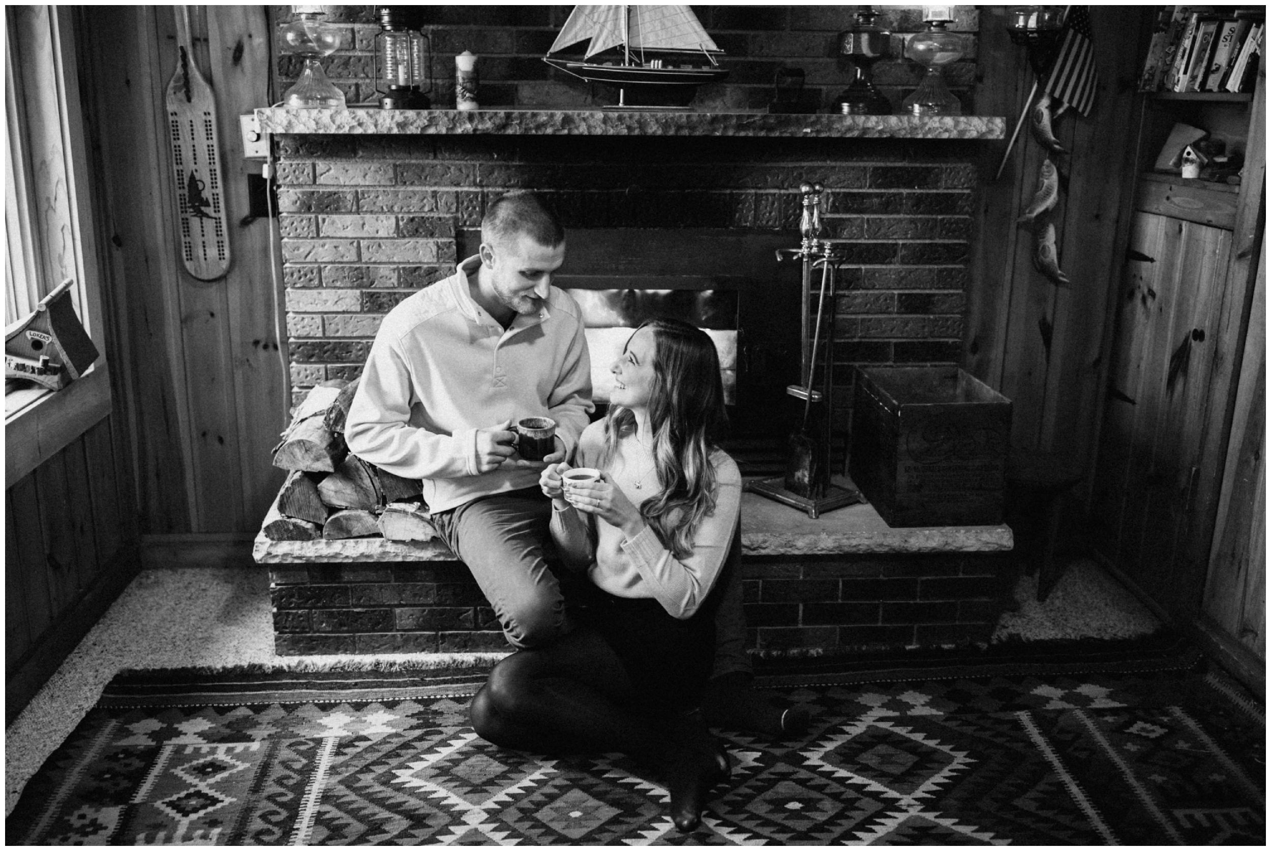 Cabin engagement shoot with morning coffee by the fireplace in the northwoods of Minnesota