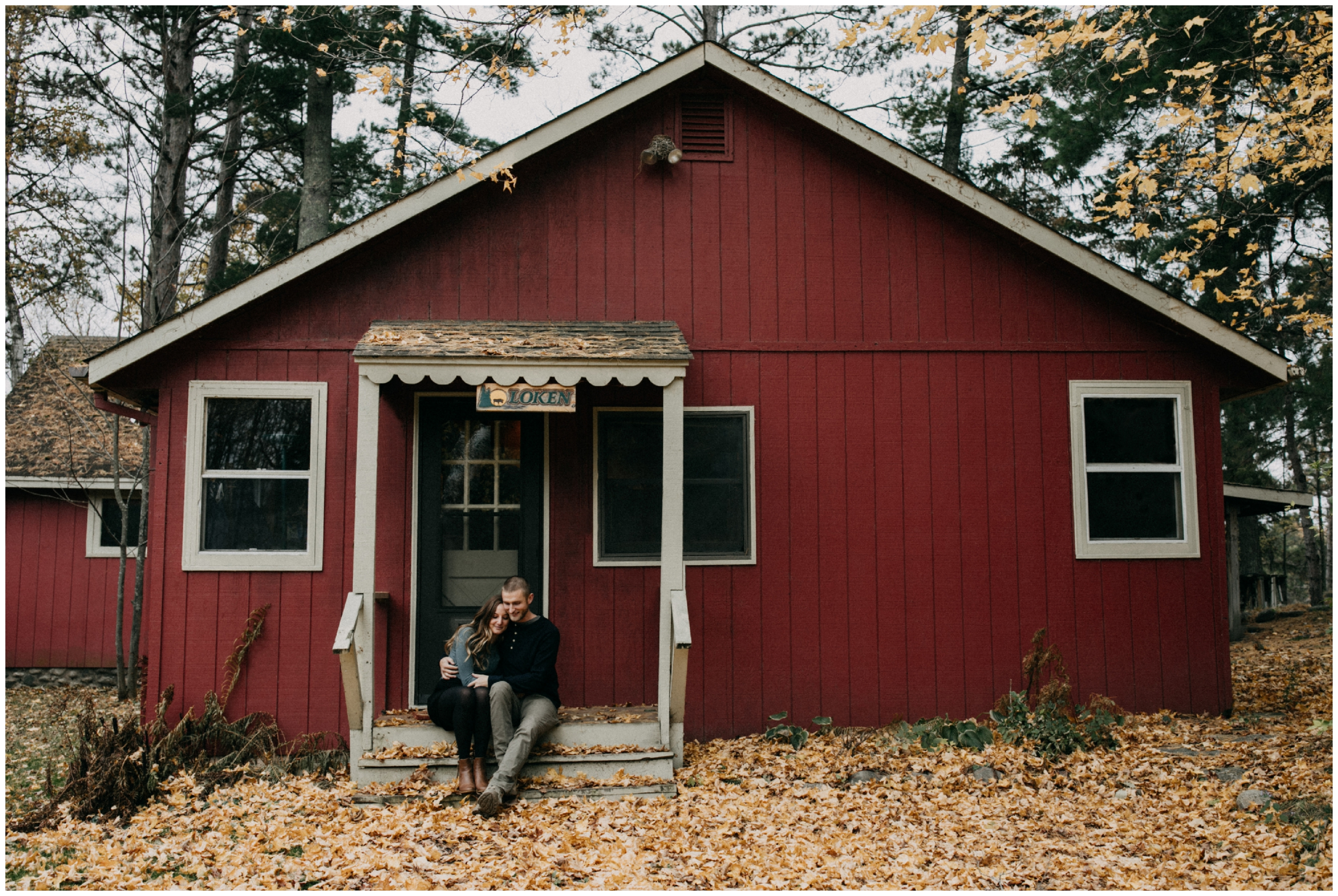 Engagement photography shoot at cute little red cabin on the lake in Hackensack, Minnesota