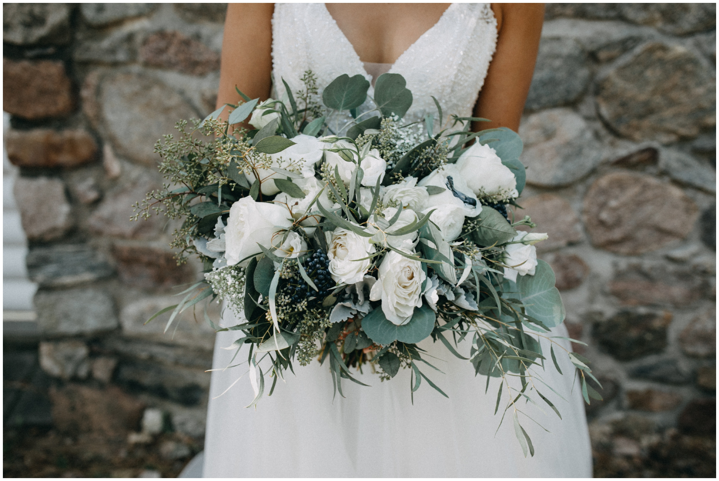 Beautiful white rose and organic greenery wedding bouquet at Camp Foley photographed by Britt DeZeeuw