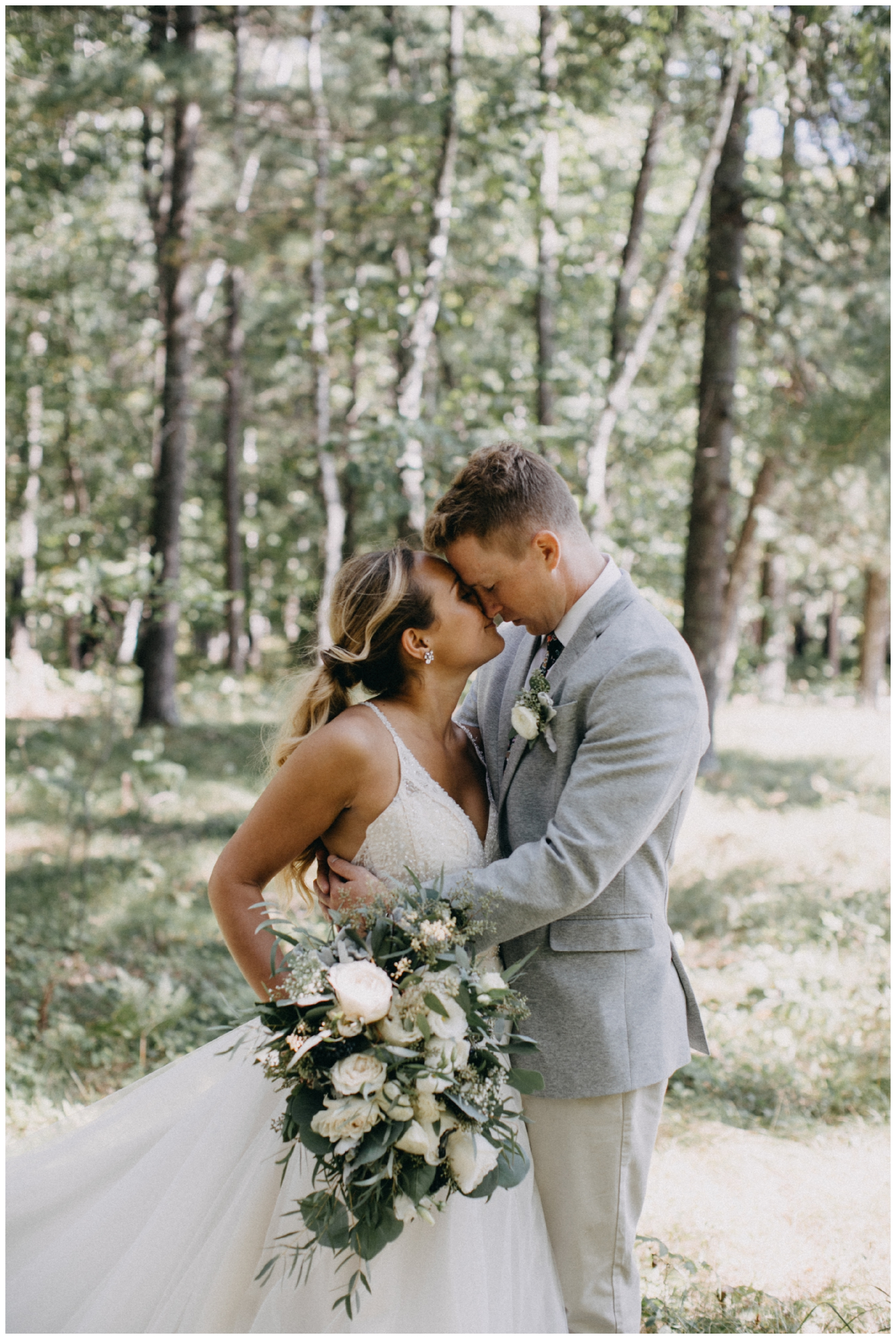 Romantic woodsy summer camp wedding in Pine River Minnesota photographed by Britt DeZeeuw