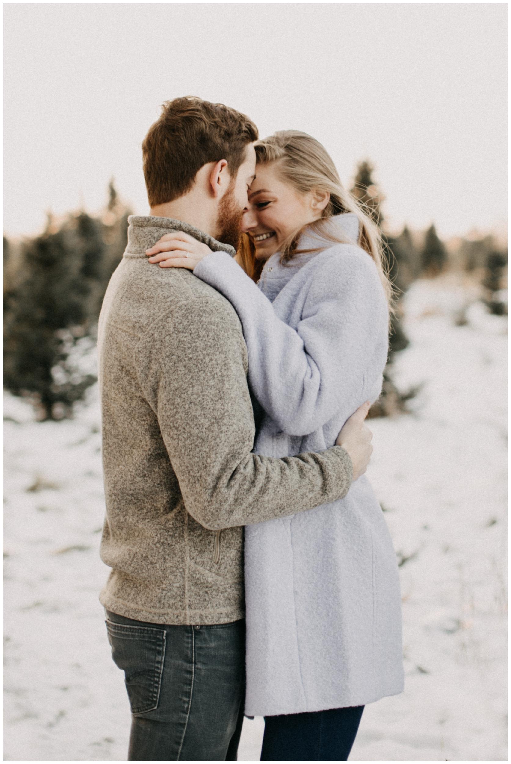 Cozy, outdoor winter engagement session at Hansen Tree farm by Minnesota wedding photographer Britt DeZeeuw
