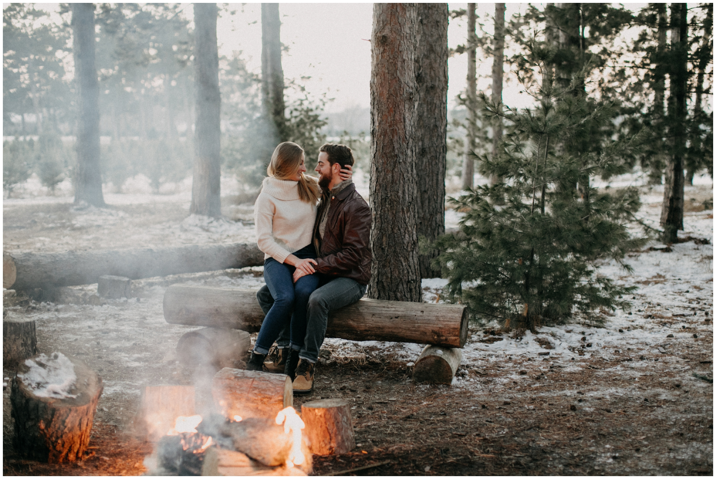 Romantic and cozy winter bonfire engagement session by Brainerd photographer Britt DeZeeuw