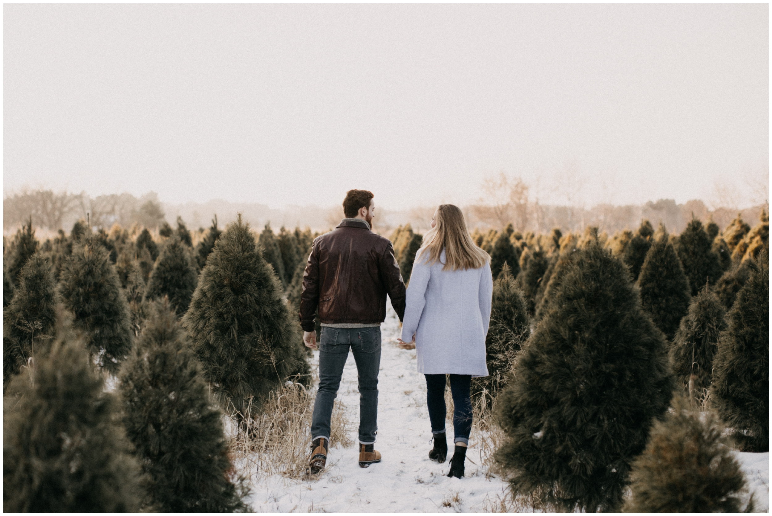 Pine tree forest winter engagement session in Minnesota
