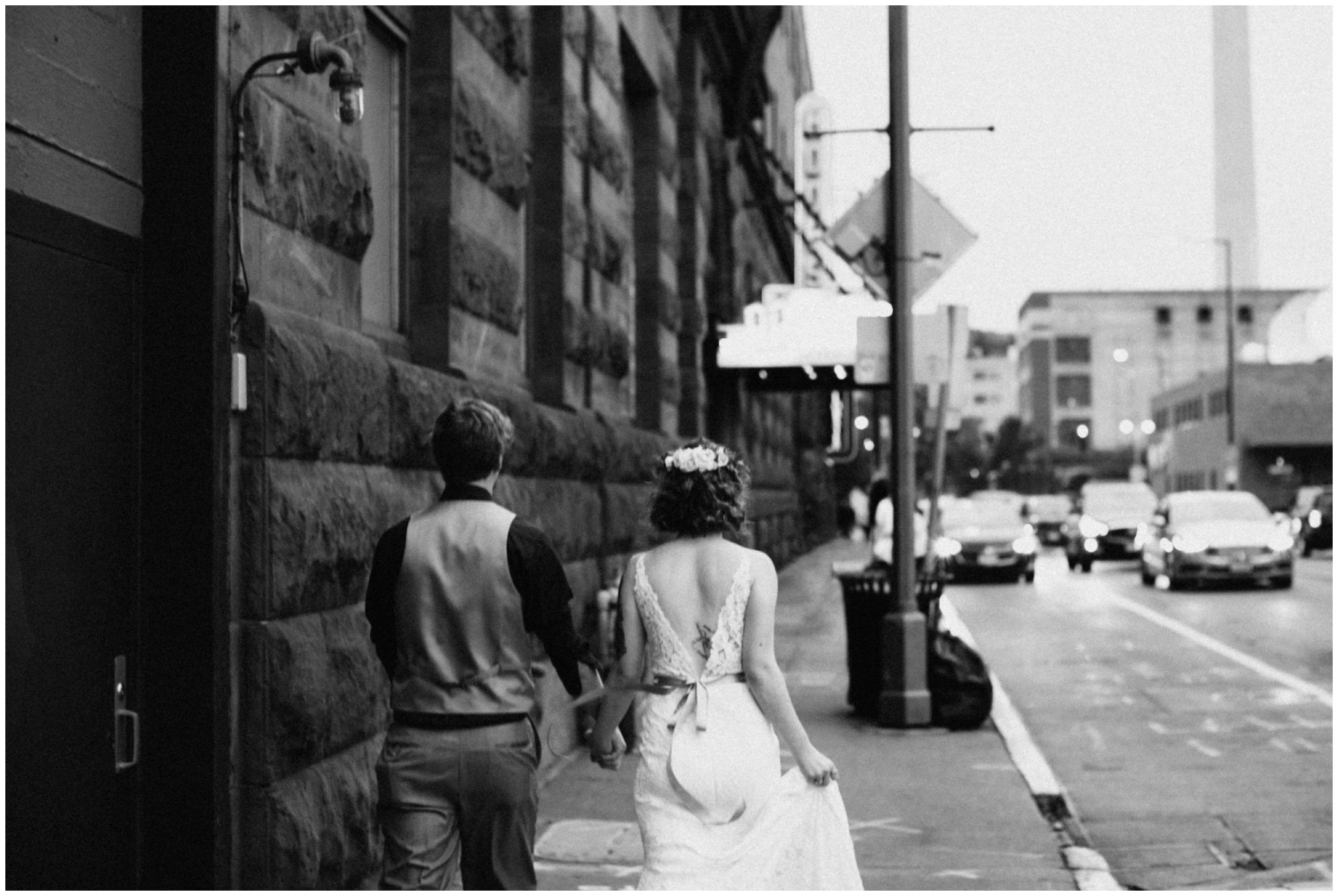 Bride and groom walking in canal park by Duluth wedding photographer Britt DeZeeuw