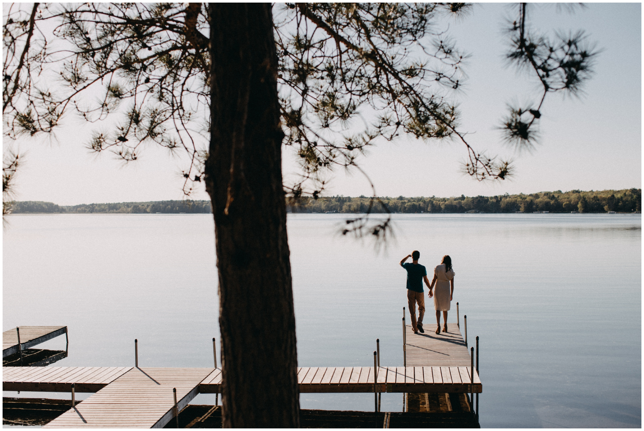 Minnesota summer engagement session during sunset on Crosslake photographed by Britt DeZeeuw