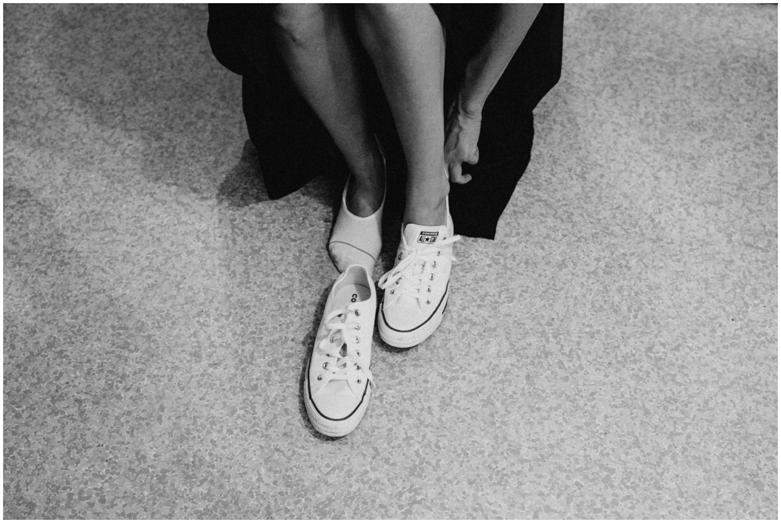 Bridesmaid wearing converse tennis shoes at causal, laid back Camp Foley wedding