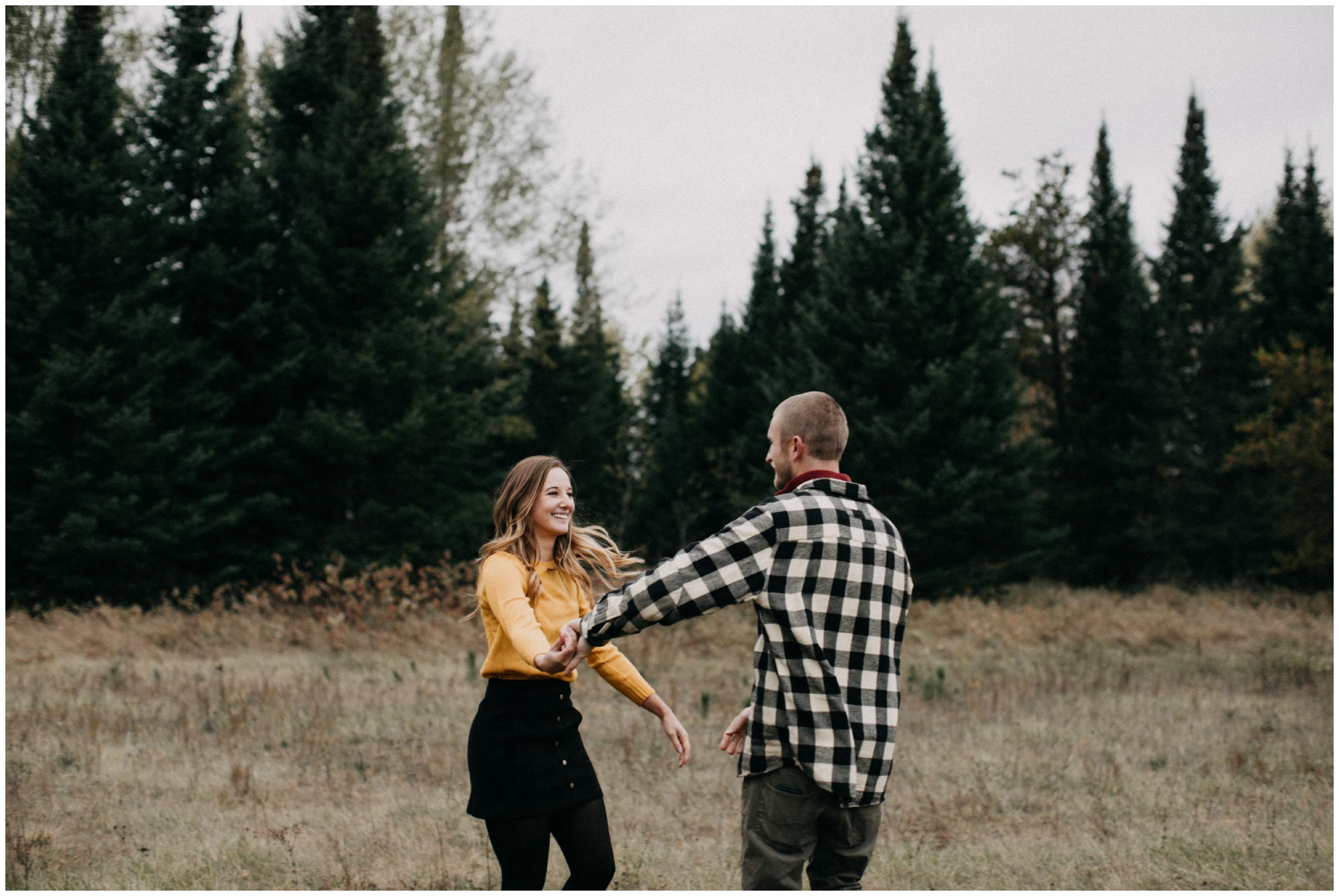 Pine tree forest engagement session by Brainerd Minnesota photographer Britt DeZeeuw