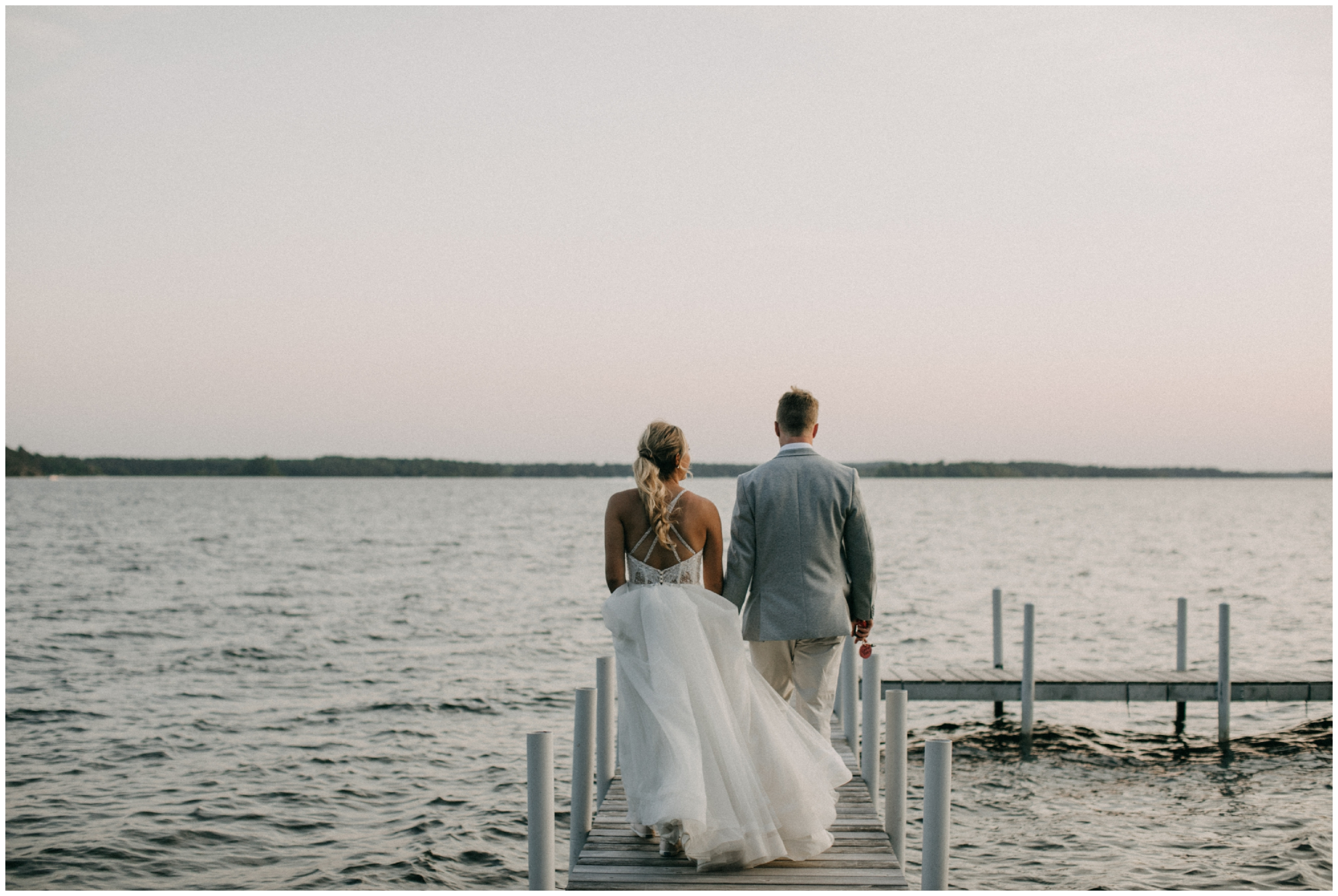 Summer camp wedding at sunset on Crosslake photographed by Britt DeZeeuw