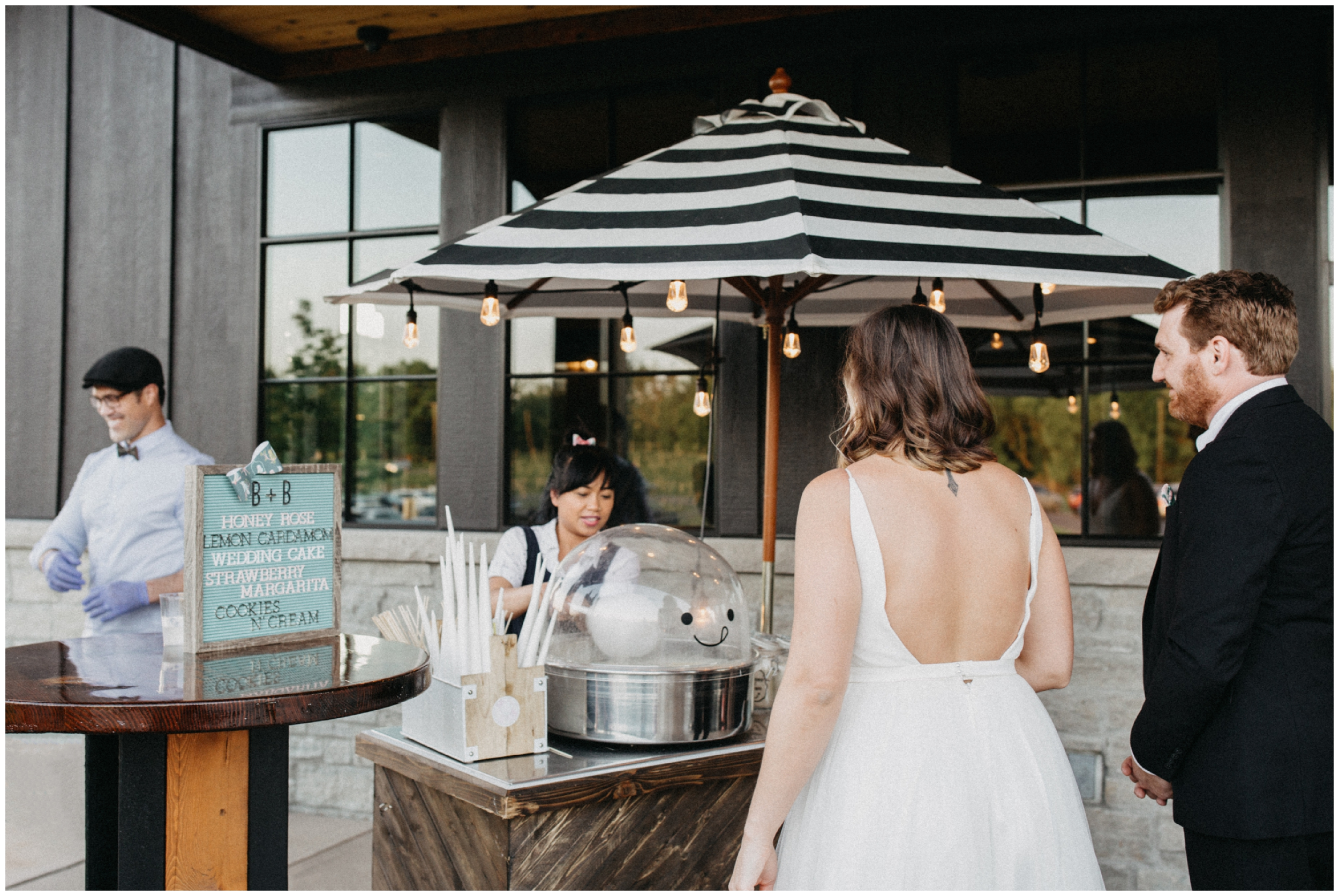 Bride and groom with cotton candy cart at Minnesota winery wedding reception