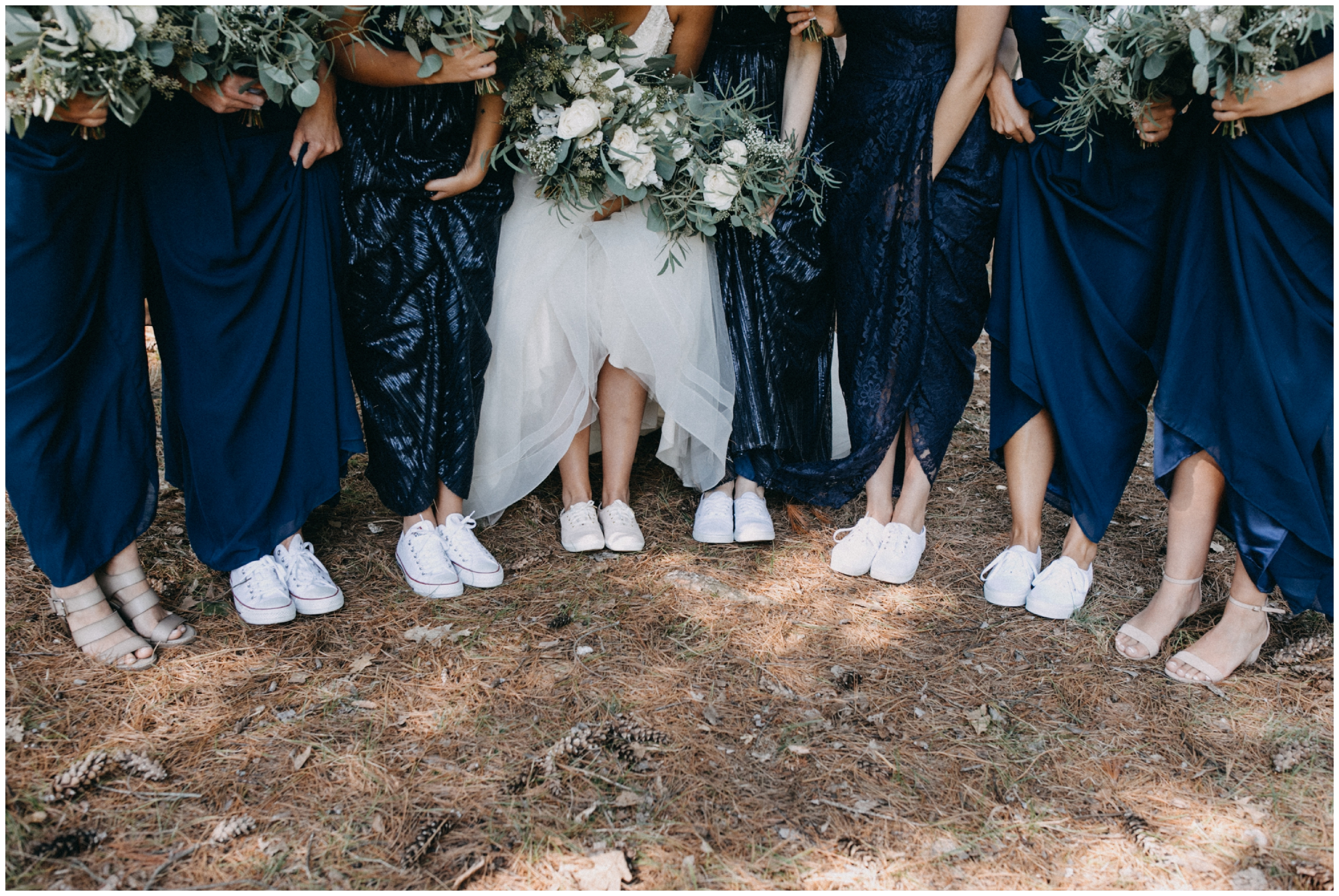 Bridesmaids wearing tennis shoes and casual and fun summer camp wedding in Pine River MN