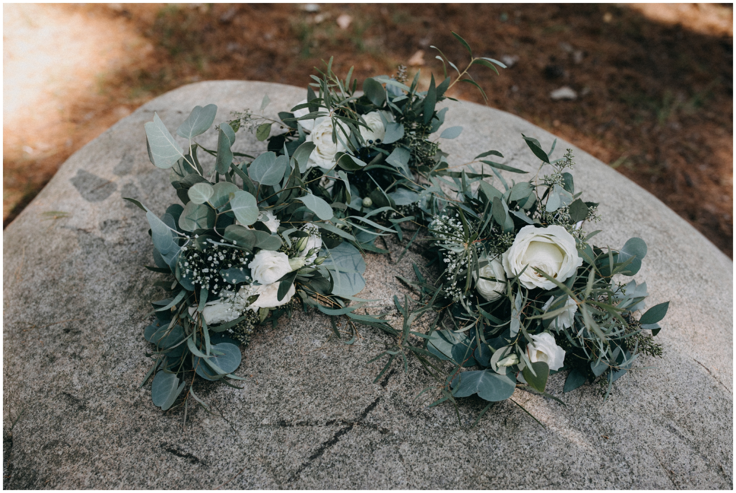 Natural greens and white rose wedding bouquets at Camp Foley