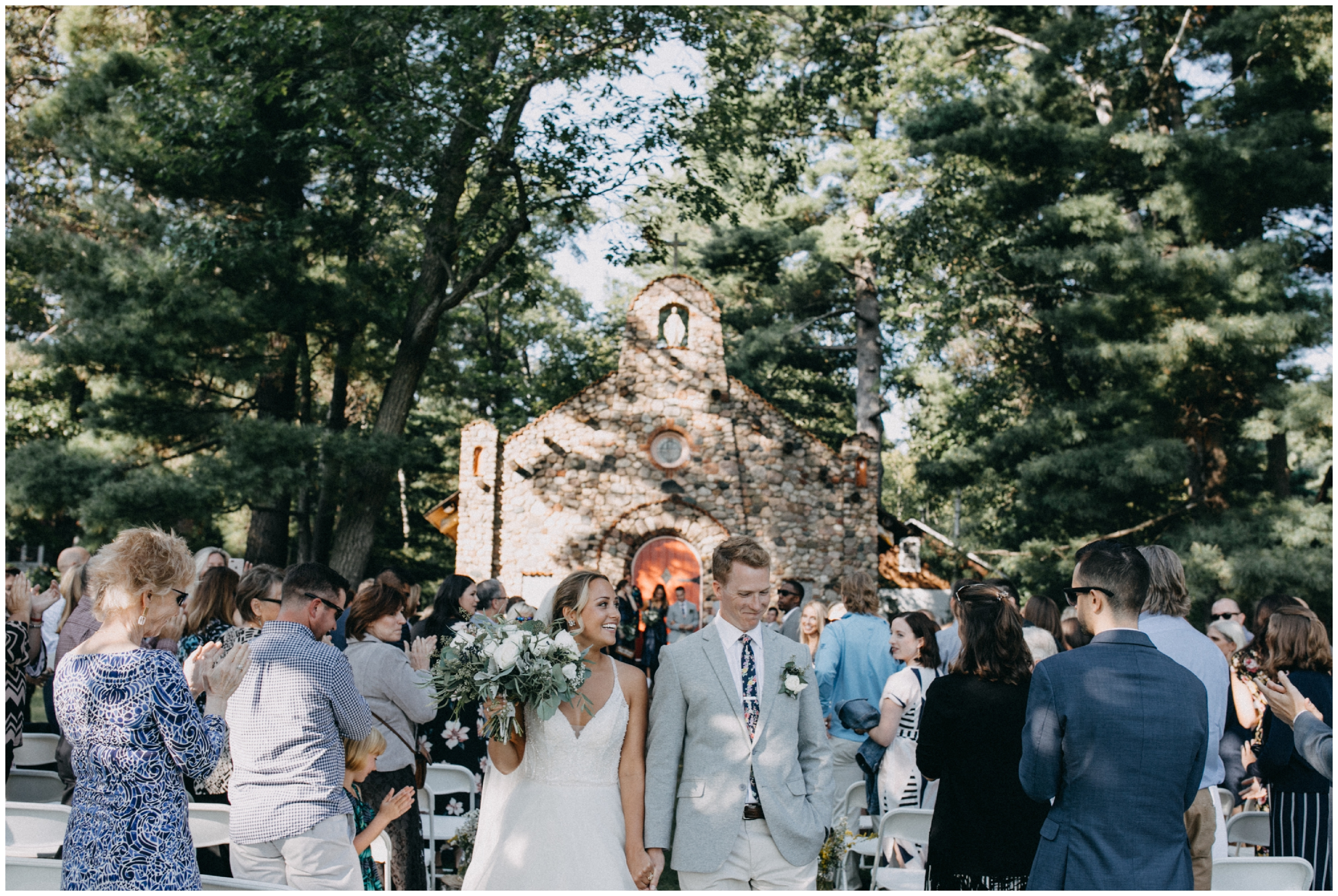 Stone chapel in the woods wedding ceremony at Camp Foley