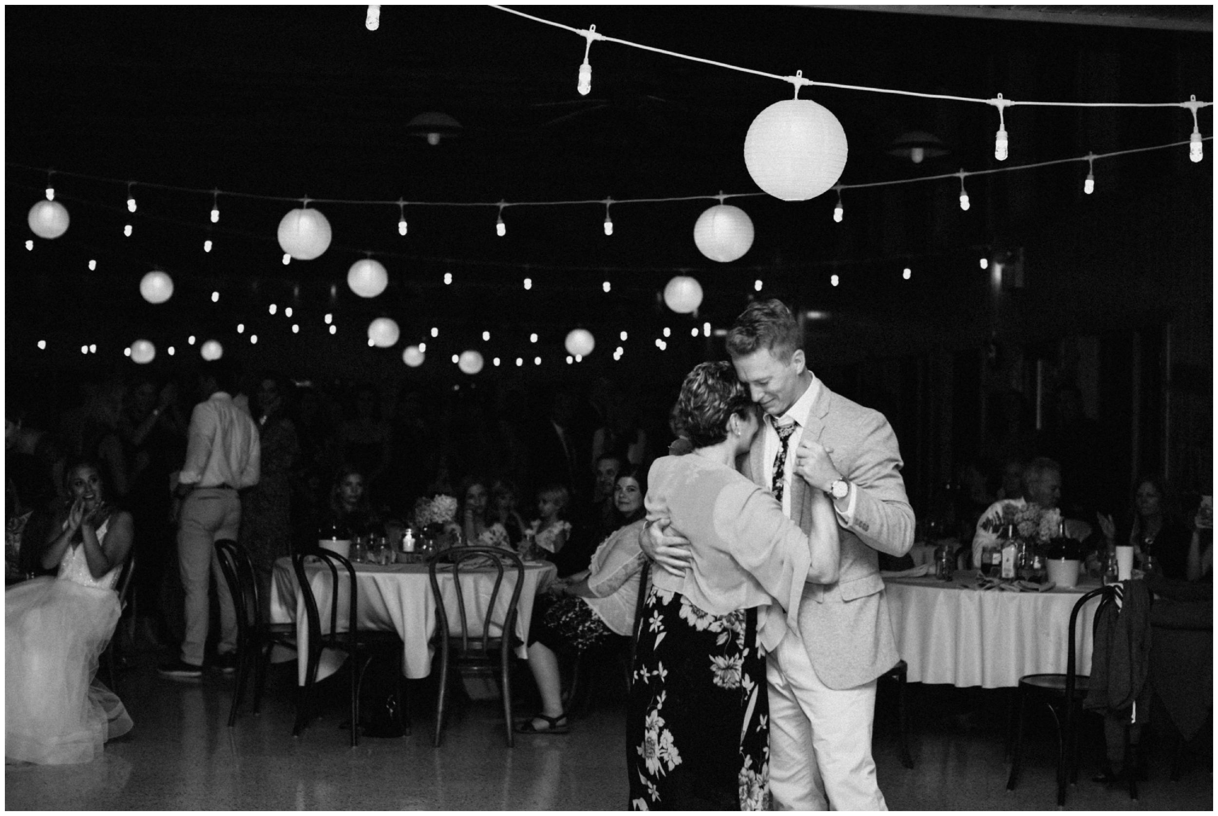 Groom and mom dancing at Camp Foley wedding