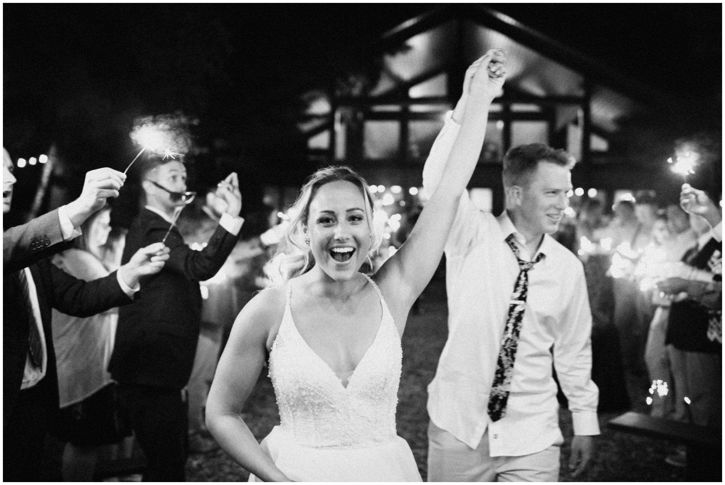 Black and white wedding sparkler exit at Camp Foley in Pine River