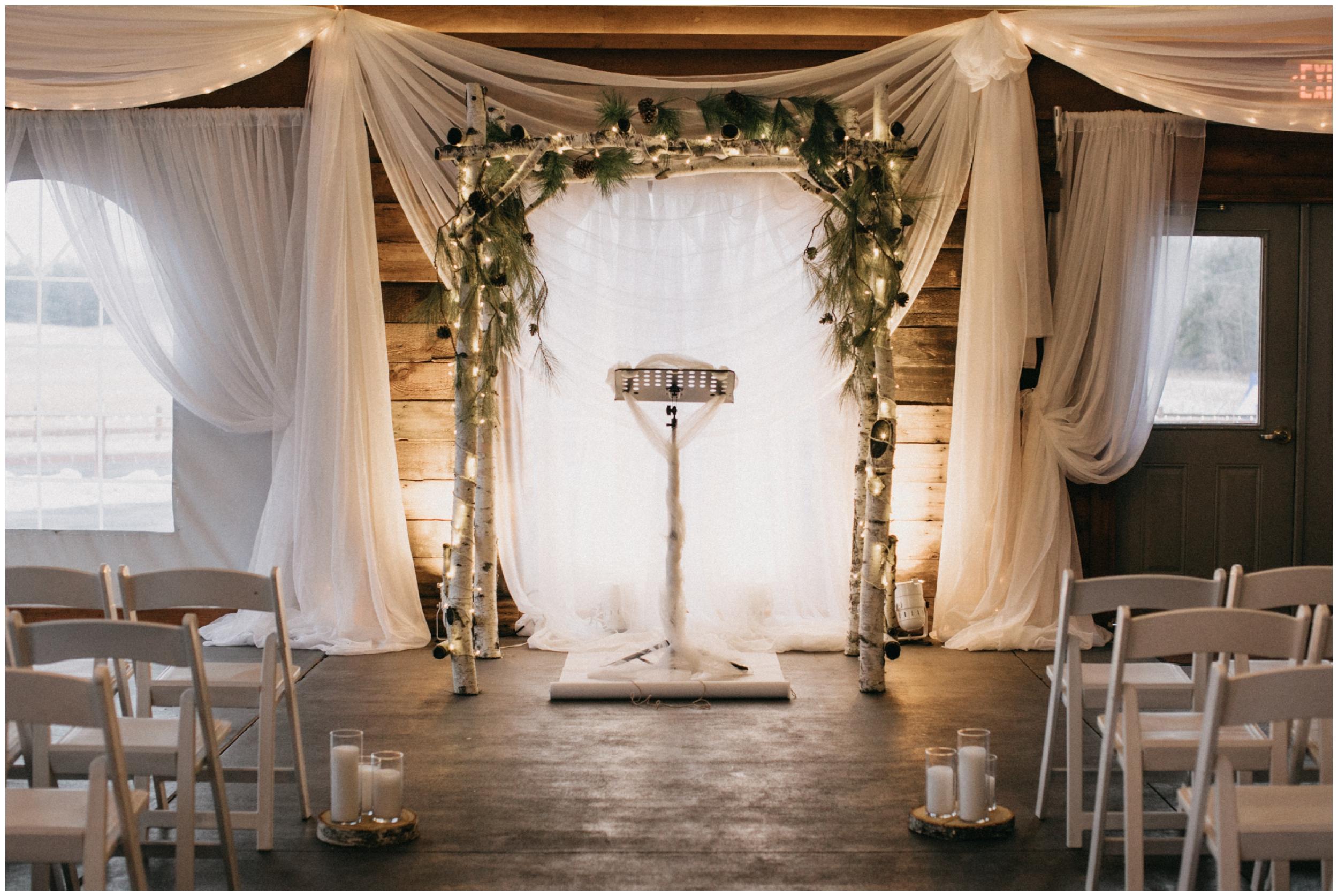 Pine Peaks winter wedding ceremony in Crosslake MN