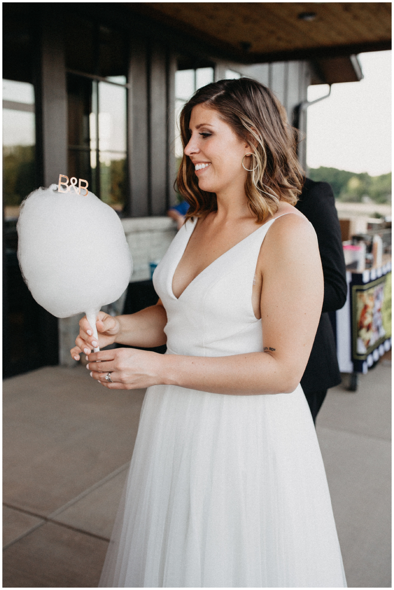 Bride with cotton candy at 7 vines winery