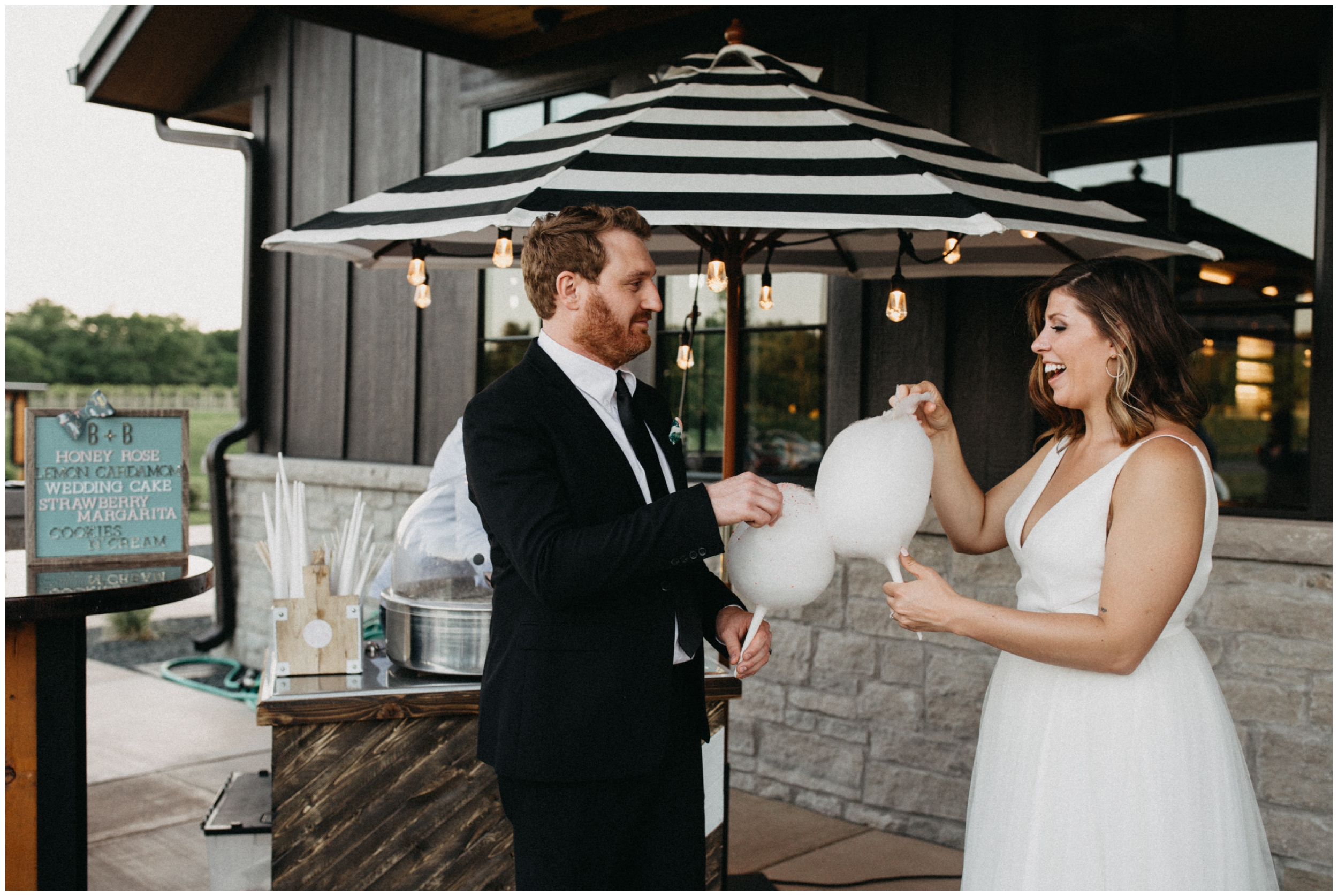 Bride and groom with cotton candy at 7 vines winery