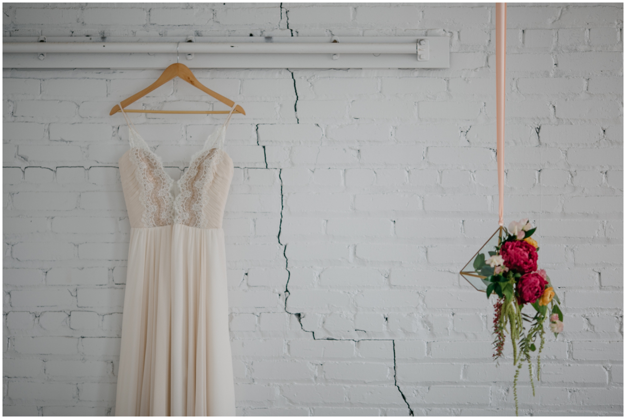 Simple and romantic wedding dress hanging at the NP Event Space