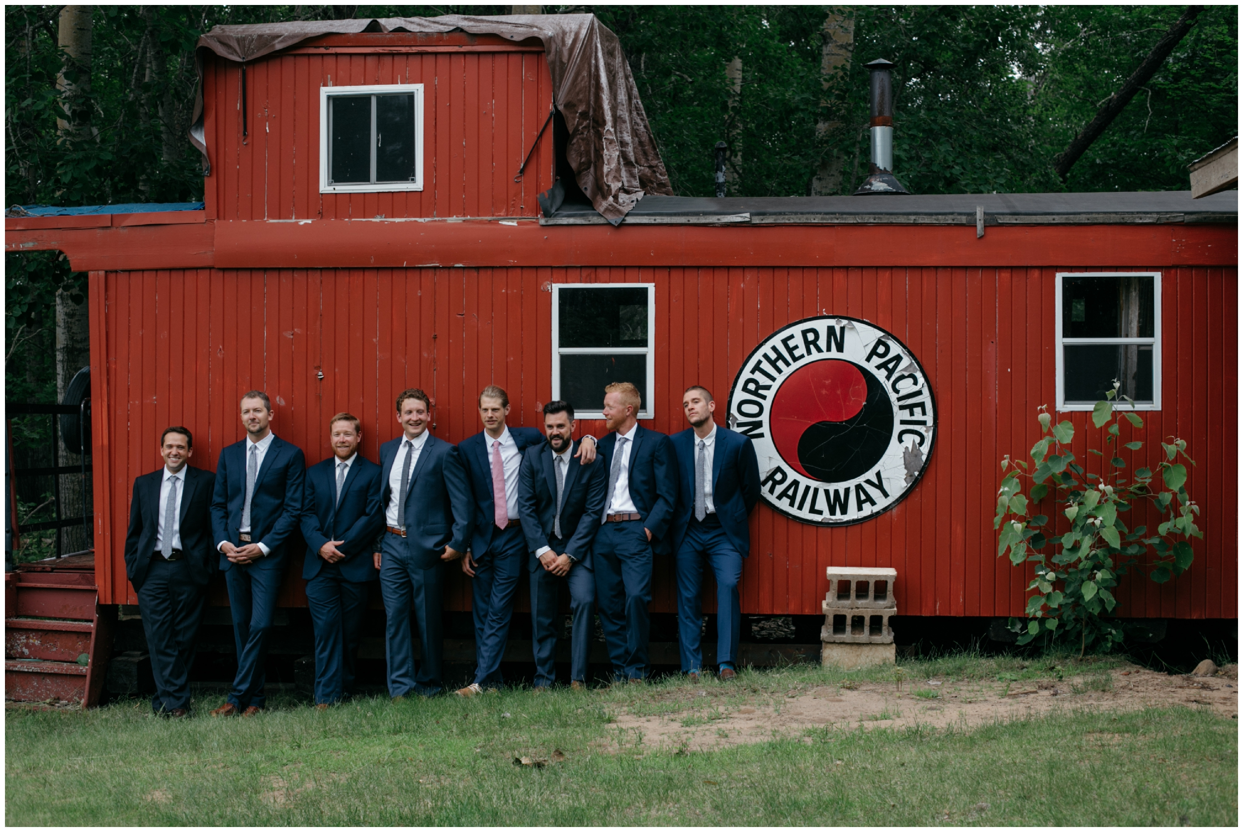 Groom and groomsmen pose candidly at the Whitely Creek Inn