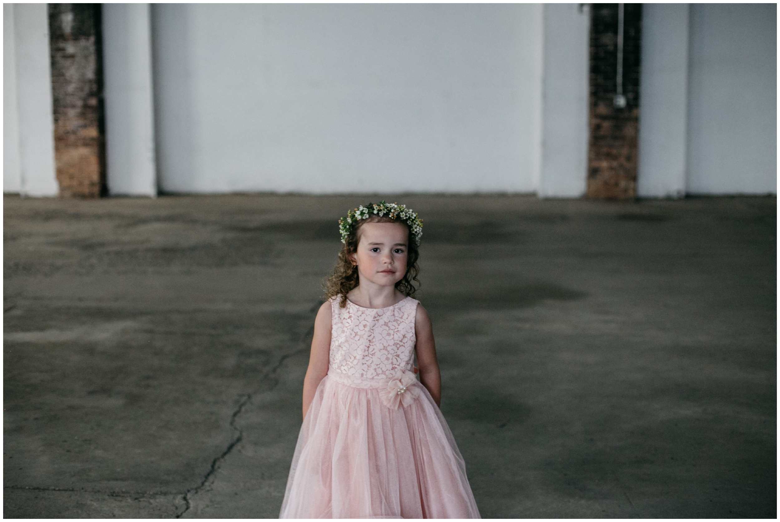 Flower girl in babies breath floral crown at the NP Event Space