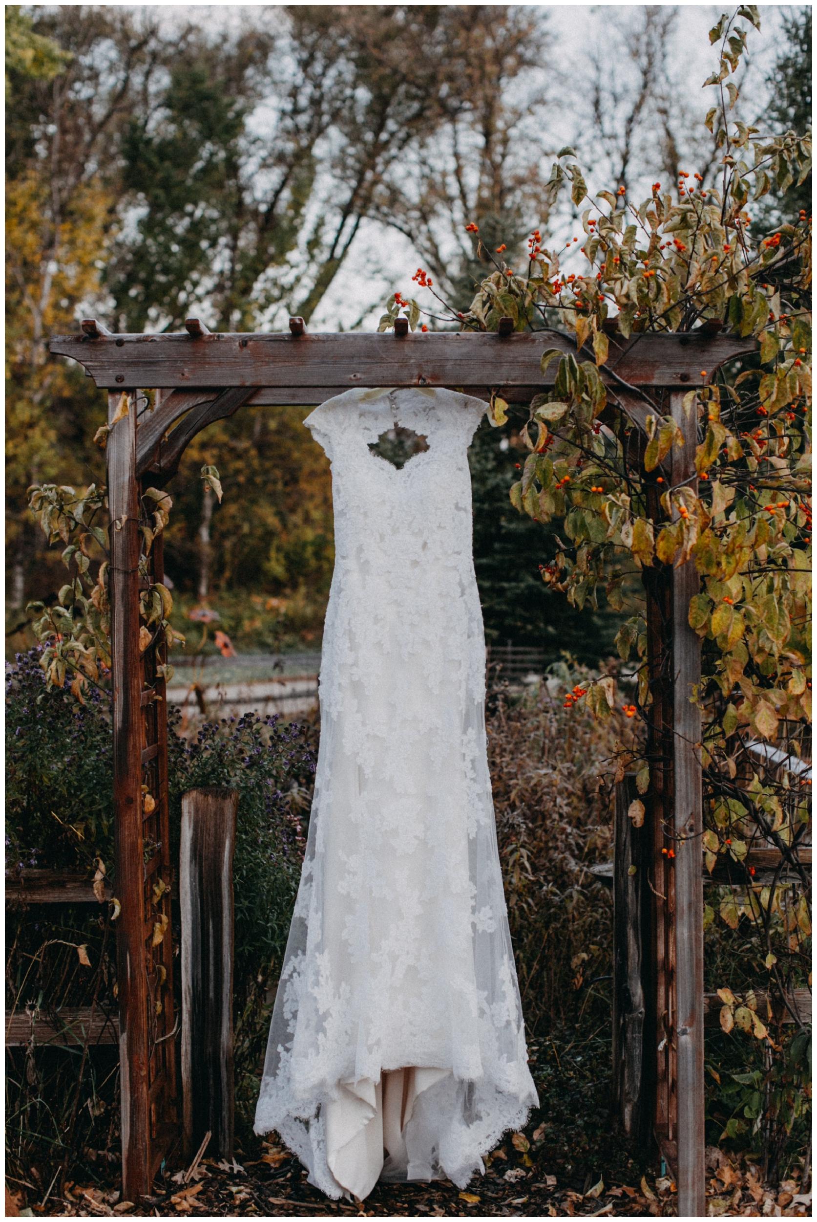 Romantic vintage wedding dress hanging outside the Northland Arboretum