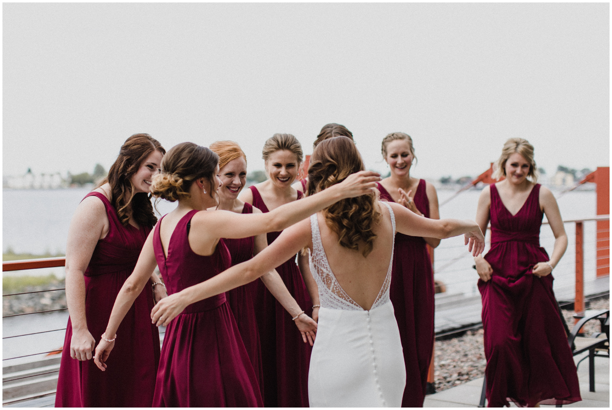 Bride and bridesmaids on the shore of lake superior at Duluth wedding