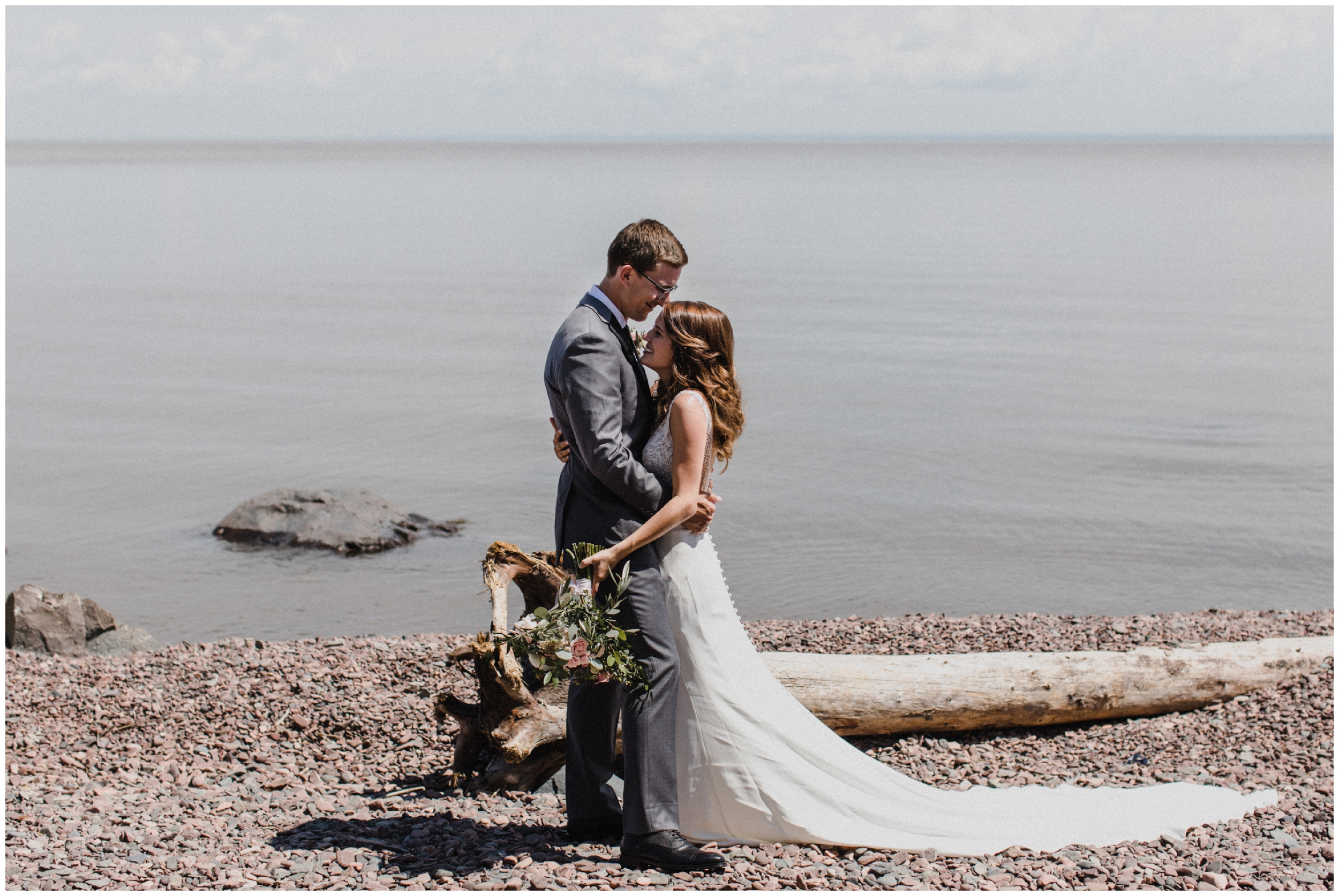 Bride and groom on the north shore of lake superior in Duluth Minnesota