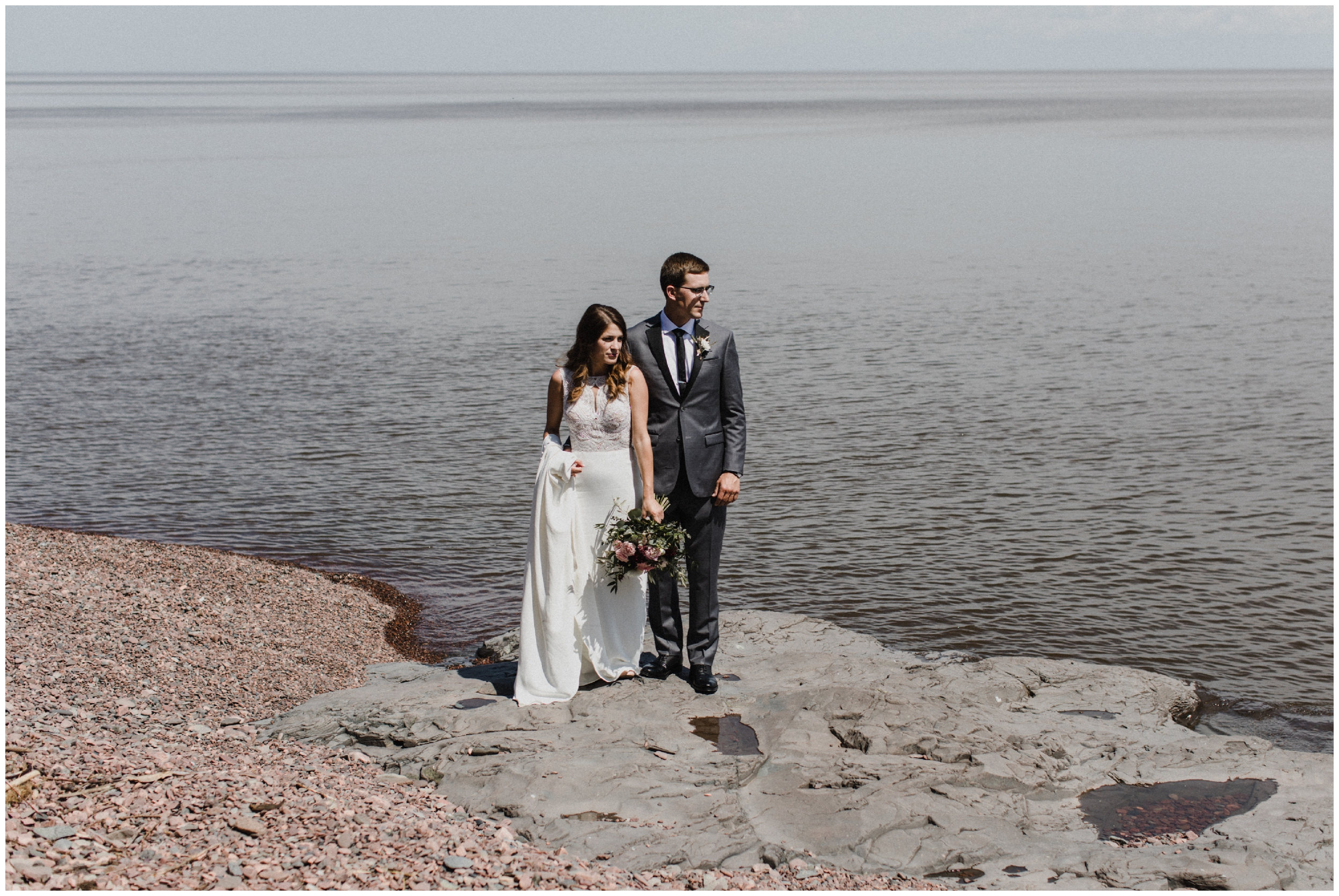 Modern portrait of bride and groom on the north shore of lake superior in Duluth Minnesota