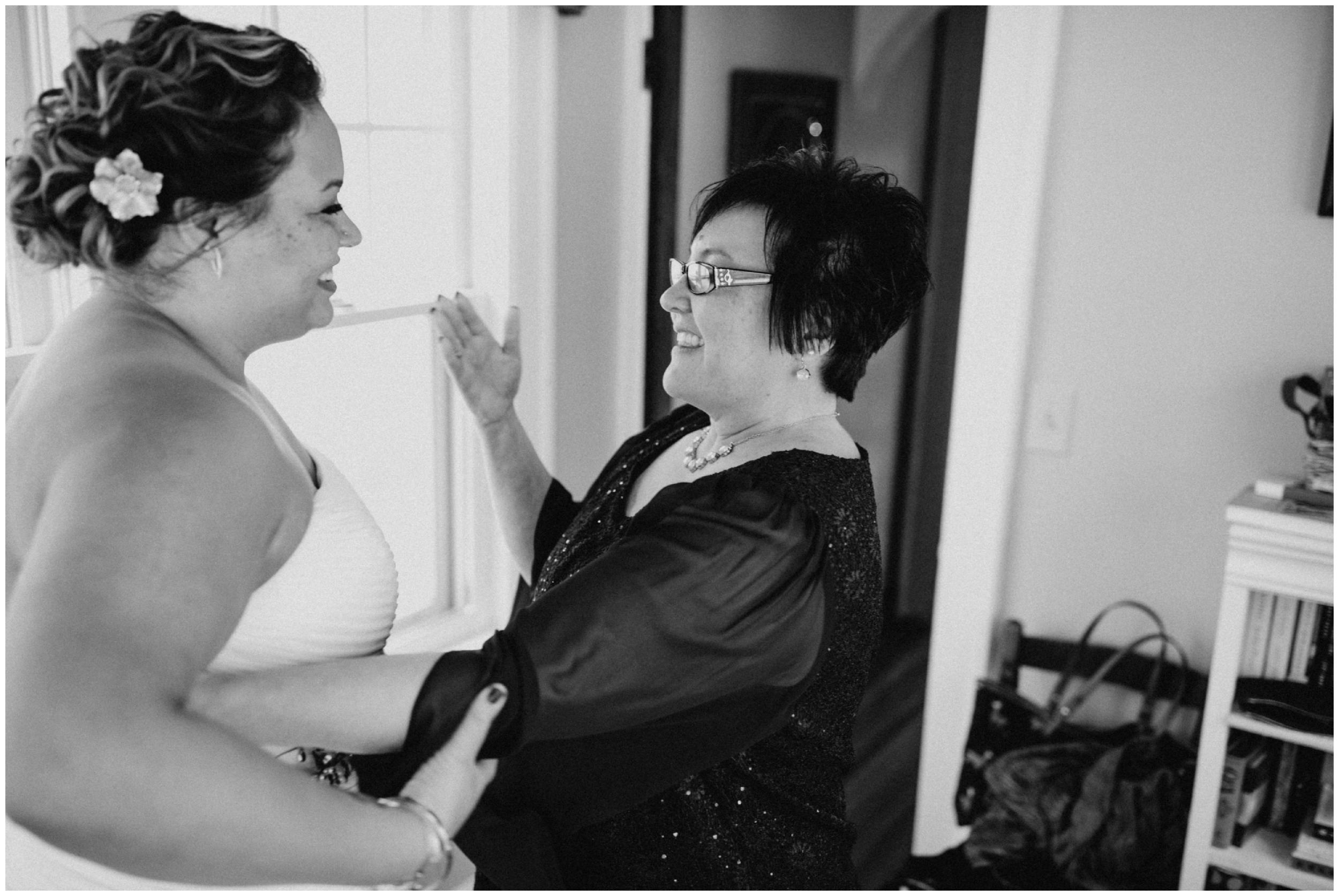 Emotional moment between bride and mom at her Minneapolis winter wedding