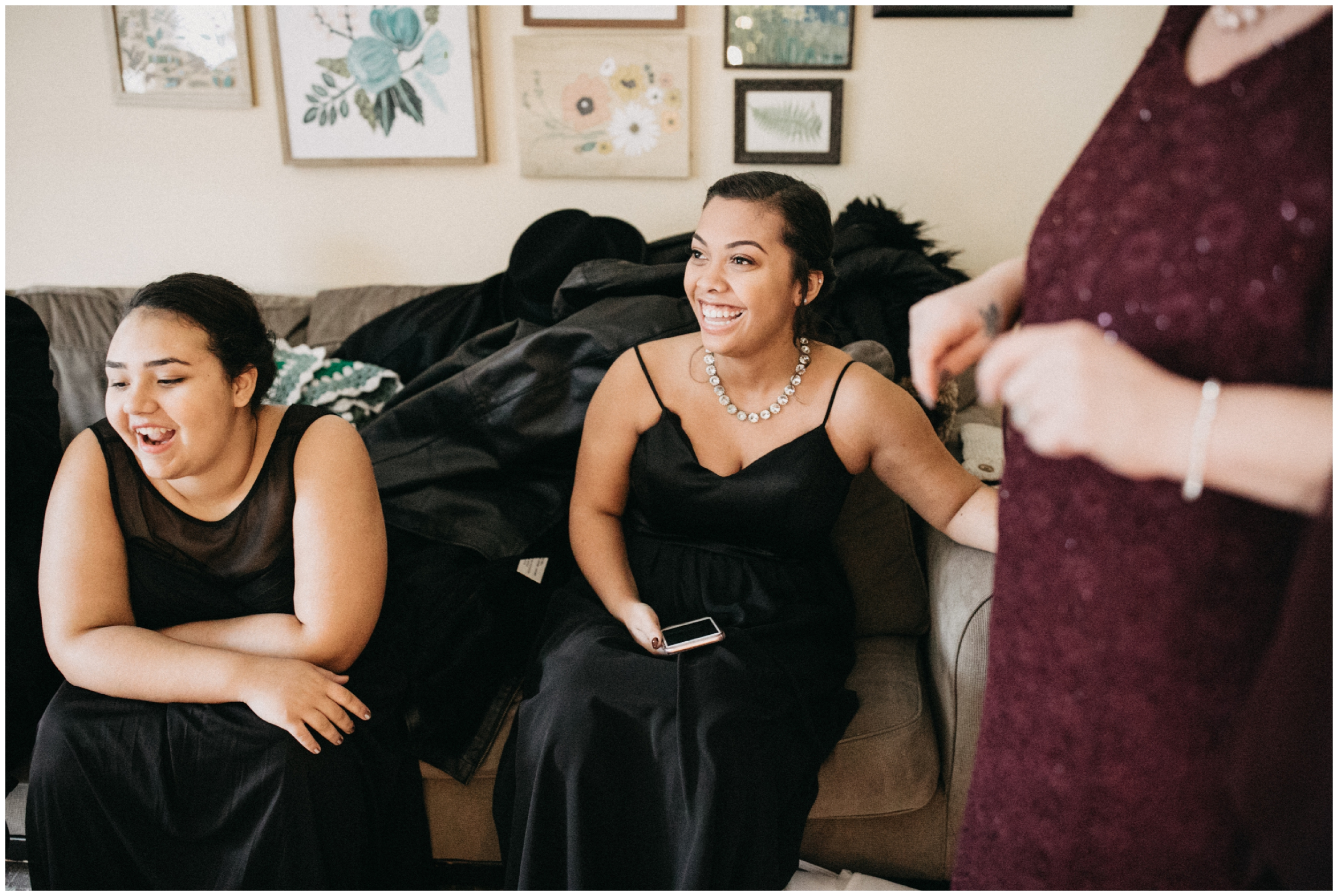 Sisters happy reactions when she shows them her wedding dress in Minneapolis Minnesota