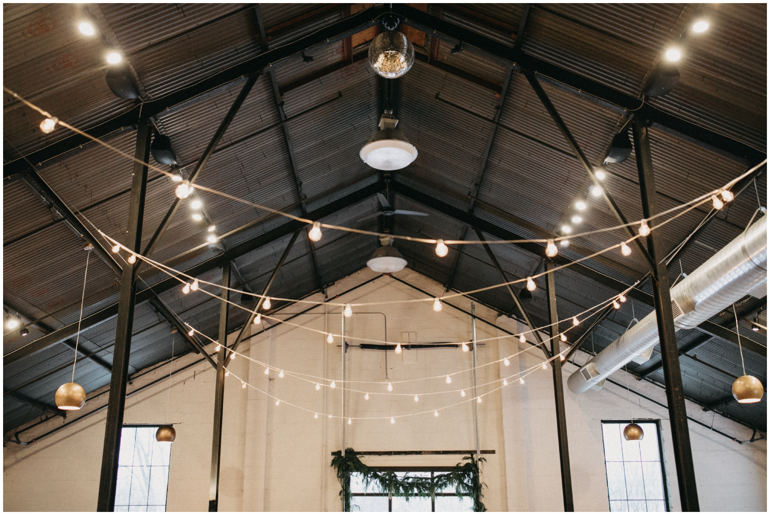 Indoor industrial wedding ceremony at Paikka