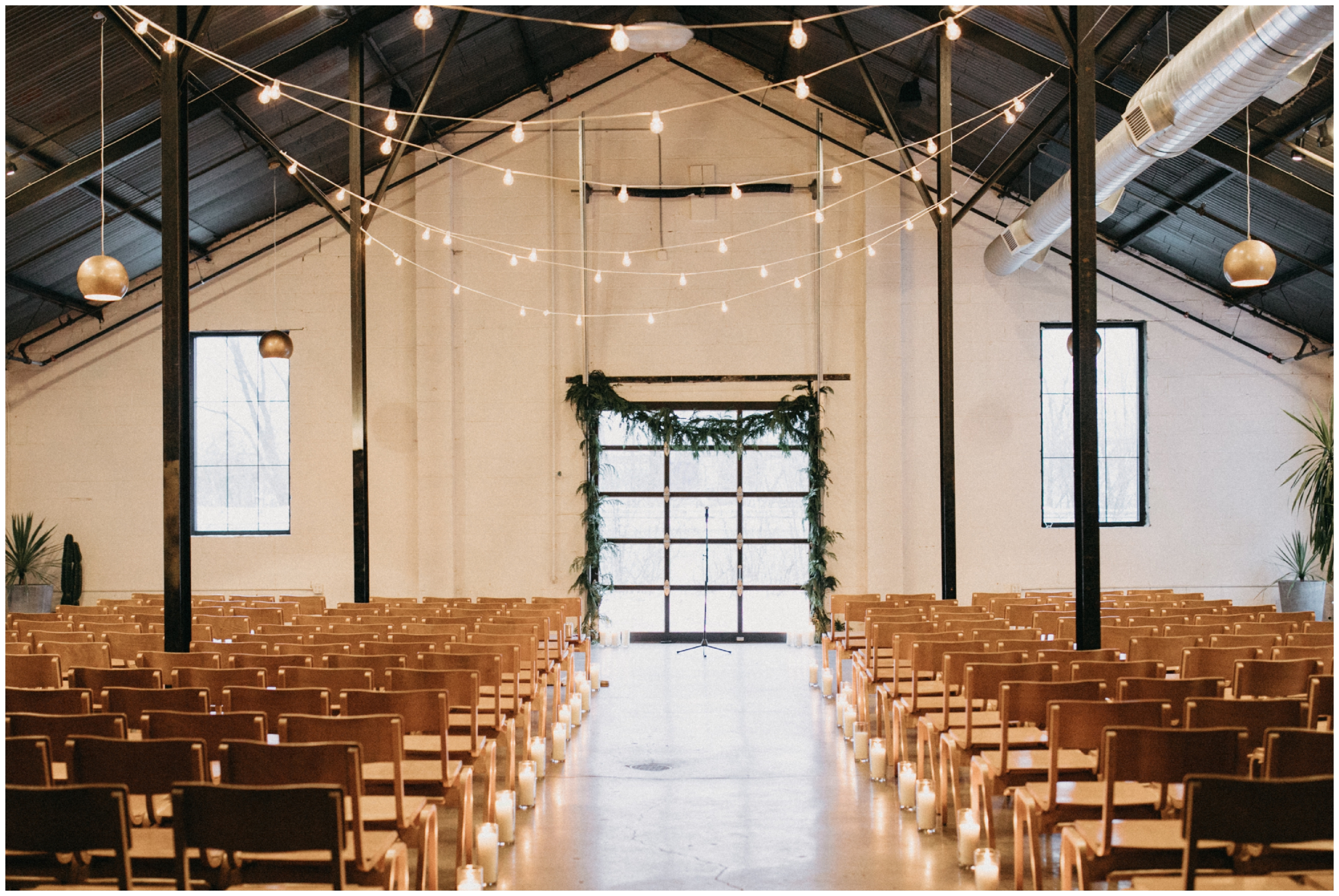 Industrial chic wedding ceremony at Paikka in St Paul Minnesota