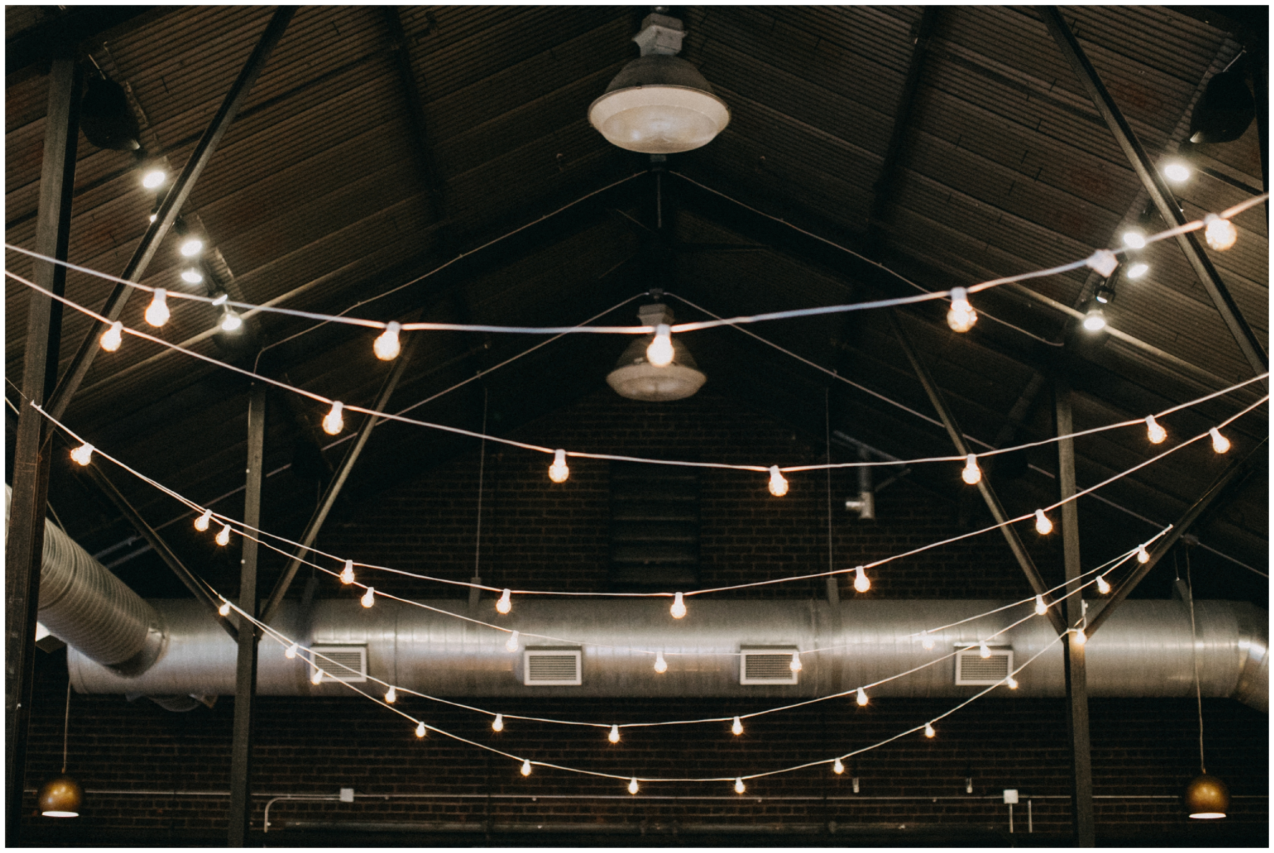 Bistro lighting decor at Paikka wedding in St Paul Minnesota