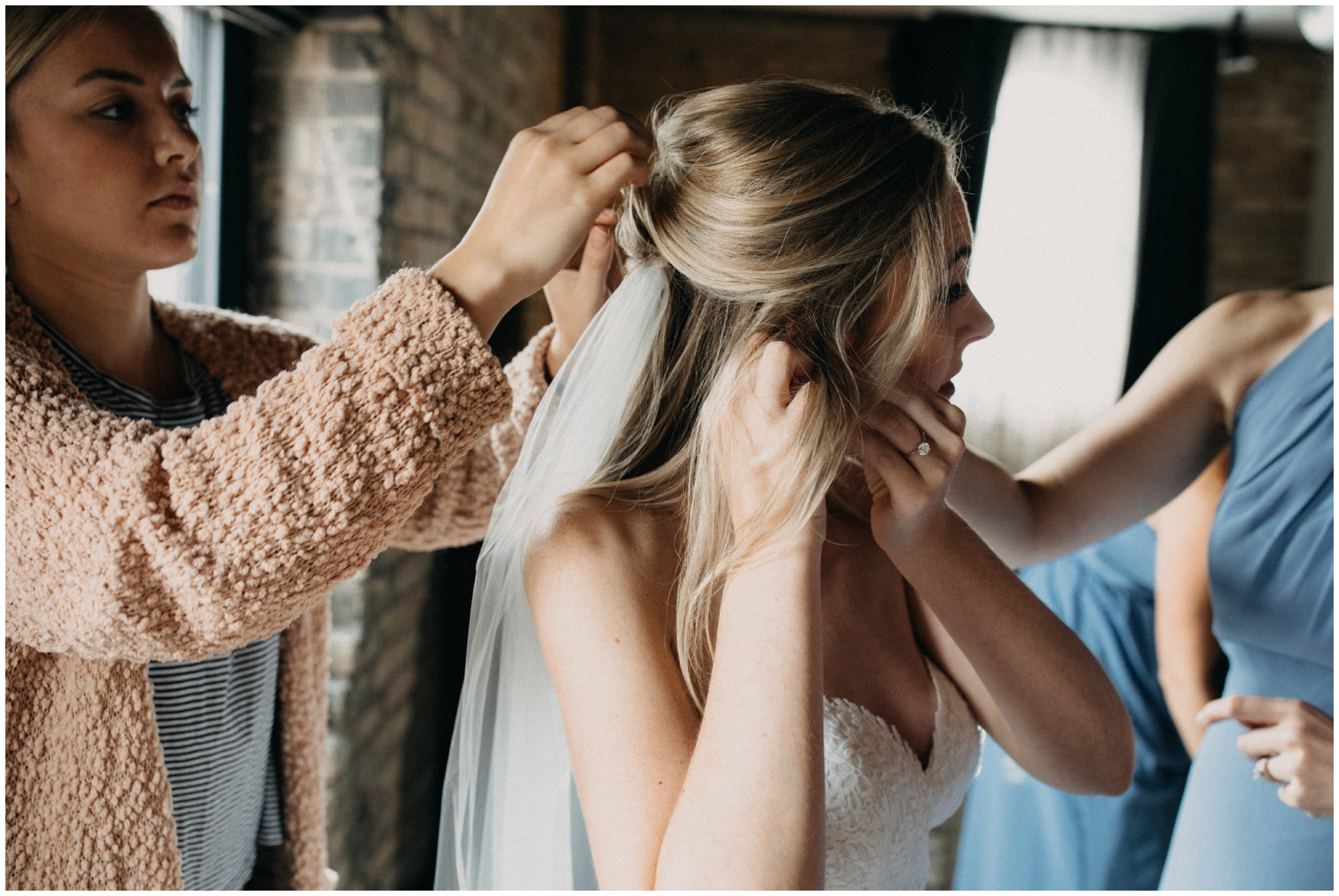 Bride getting ready at industrial chic hotel in the north loop Minneapolis