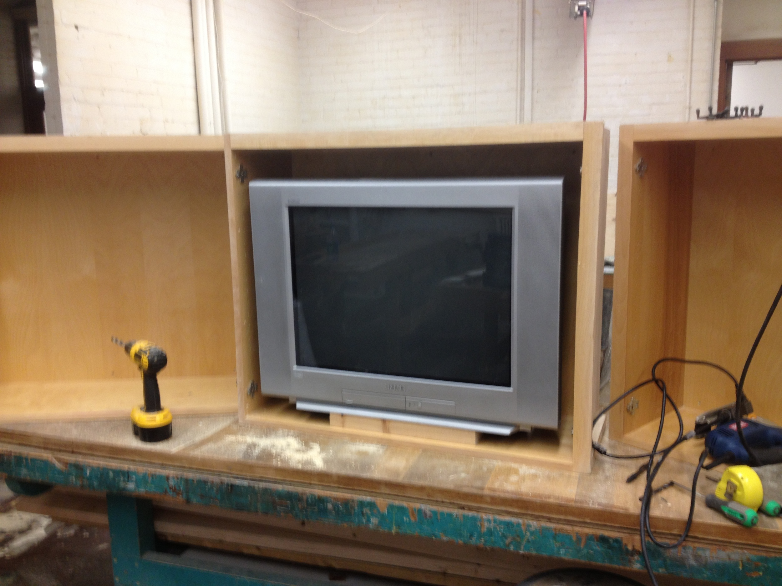 "Very start of the console, these three cabinets were screwed together and modified to hold 3 27"" tube tvs."