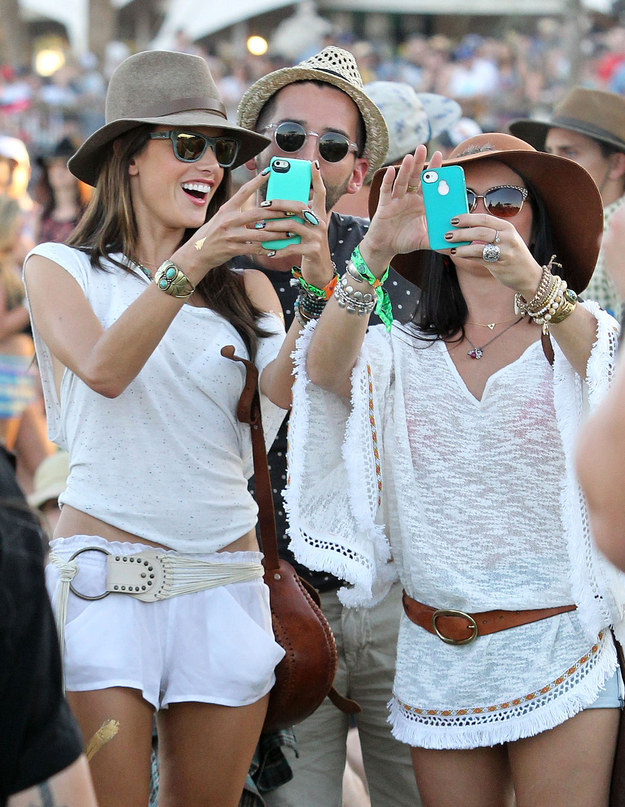 Famous people taking selfies at Coachella.