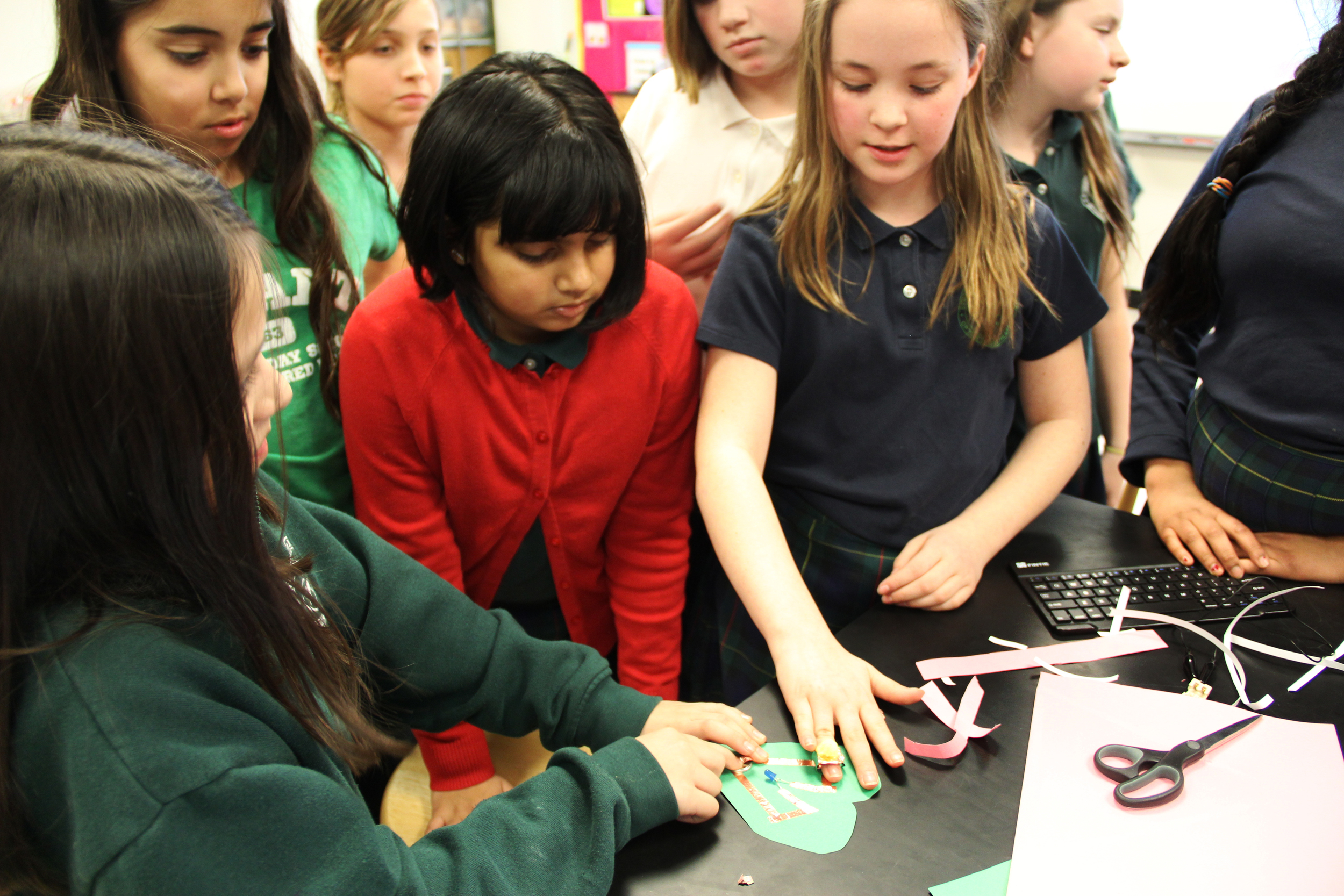 Demoing their paper circuit and wearable ring acting as a switch to light up