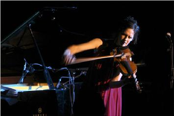 The violinist Jenny Scheinman at Le Poisson Rouge. Photo by Chang W. Lee in 2010.